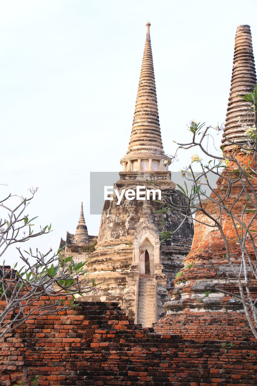 built structure, architecture, building exterior, sky, building, place of worship, belief, history, religion, spirituality, the past, low angle view, no people, clear sky, travel destinations, ancient, nature, old, outdoors, spire, ancient civilization