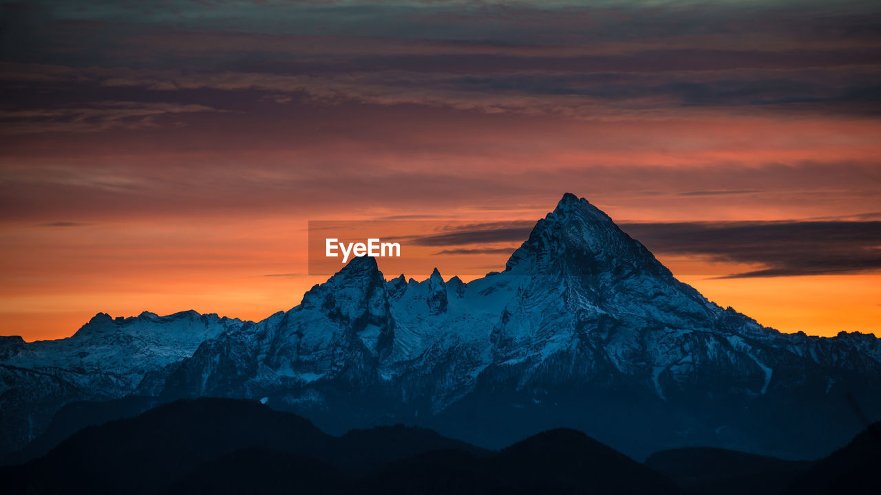 View Of Snowcapped Mountain During Sunset