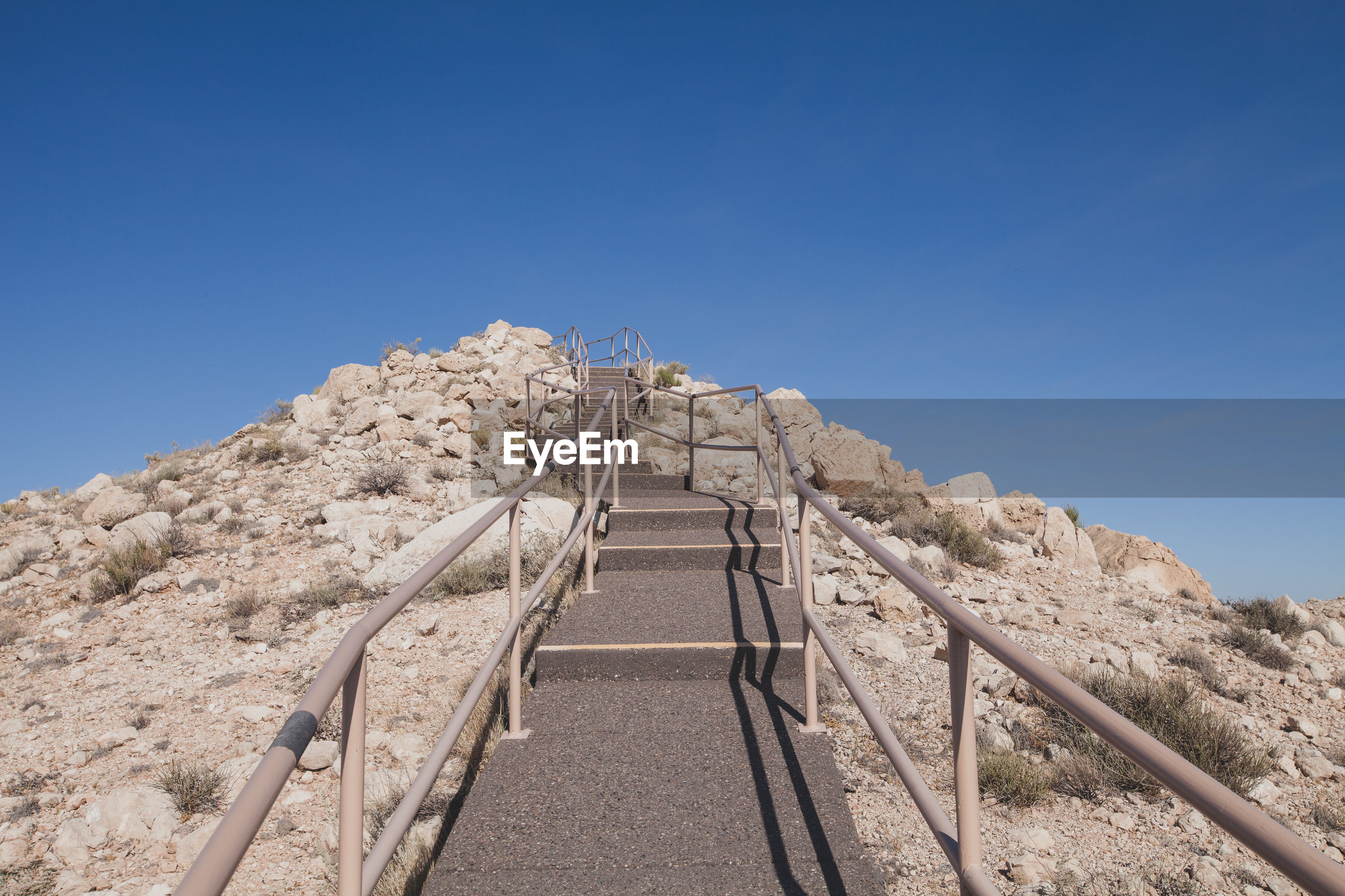 LOW ANGLE VIEW OF STAIRCASE AGAINST CLEAR SKY