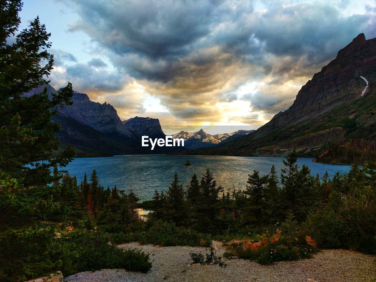 mountain, sky, beauty in nature, cloud - sky, scenics - nature, water, lake, tranquil scene, tranquility, mountain range, tree, nature, plant, non-urban scene, sunset, idyllic, no people, landscape, environment, mountain peak