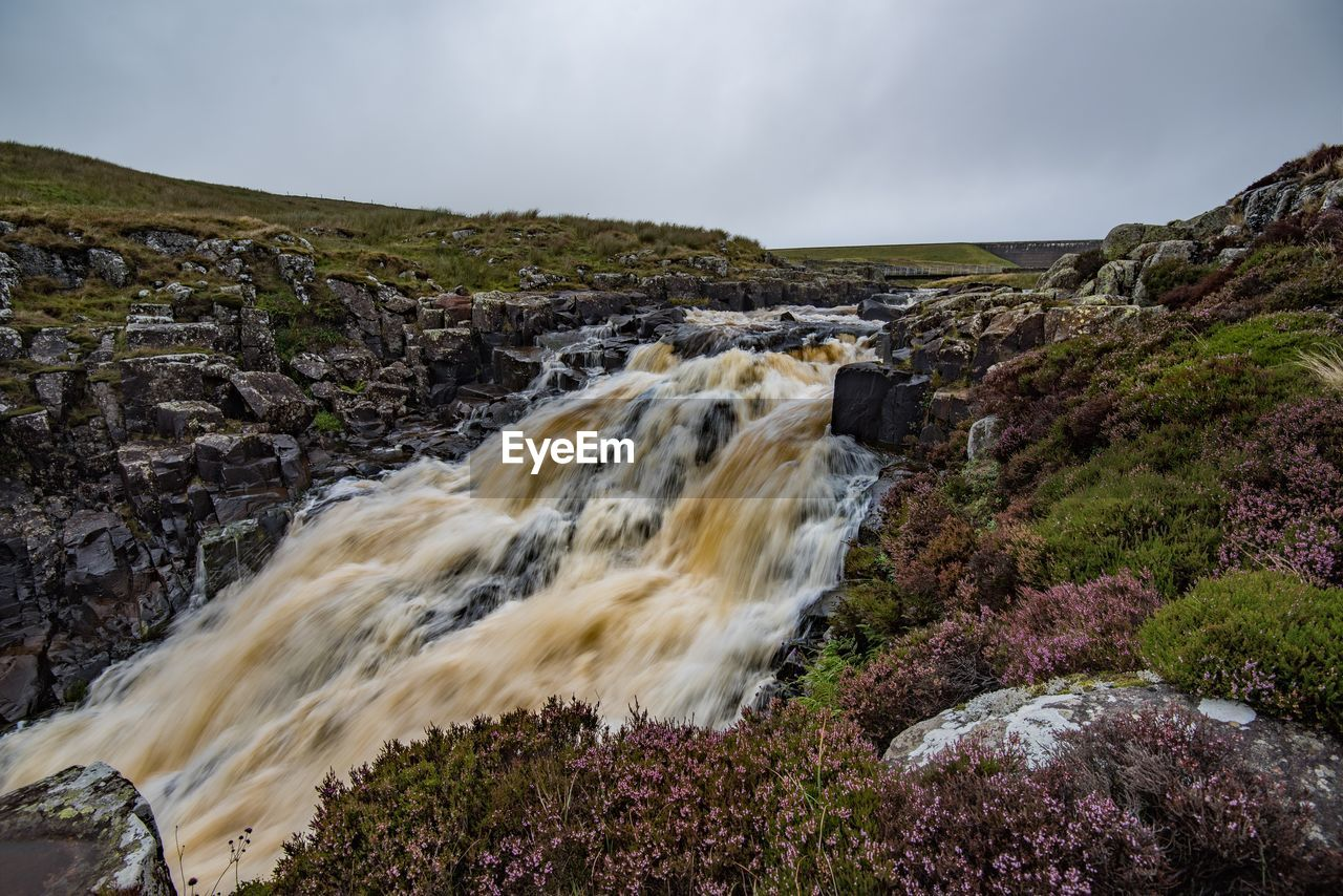 motion, sky, rock, water, scenics - nature, solid, beauty in nature, rock - object, long exposure, nature, blurred motion, no people, land, sea, flowing water, environment, waterfall, day, speed, outdoors, power in nature, flowing