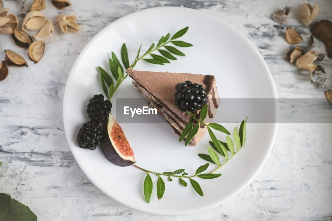 food and drink, food, table, freshness, still life, fruit, healthy eating, indoors, plate, no people, high angle view, leaf, plant part, wellbeing, ready-to-eat, indulgence, herb, close-up, berry fruit, nature, temptation, garnish, snack
