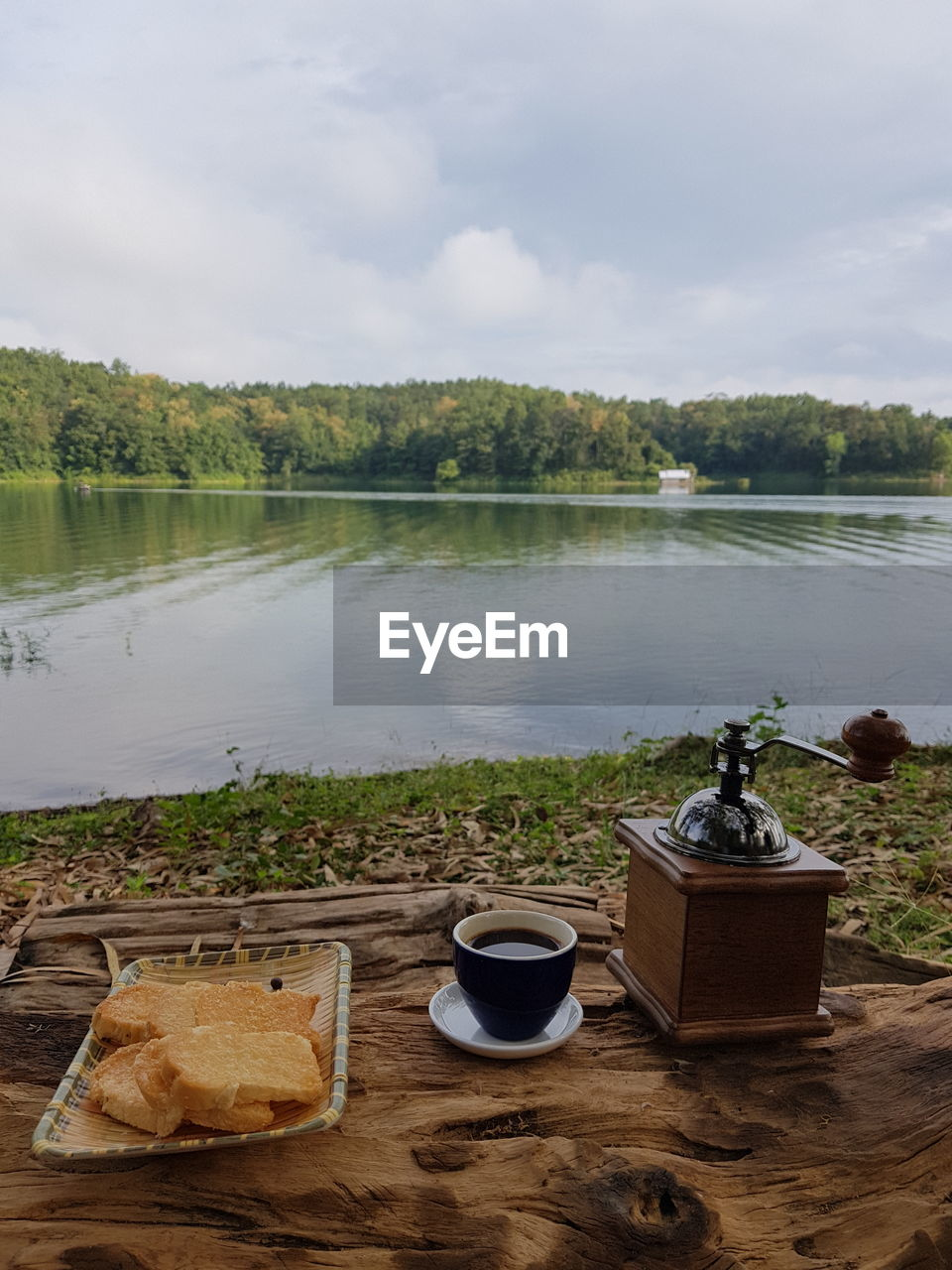 lake, water, food and drink, nature, drink, sky, refreshment, plant, cup, no people, tree, cloud - sky, food, day, mug, table, beauty in nature, tranquility, bread