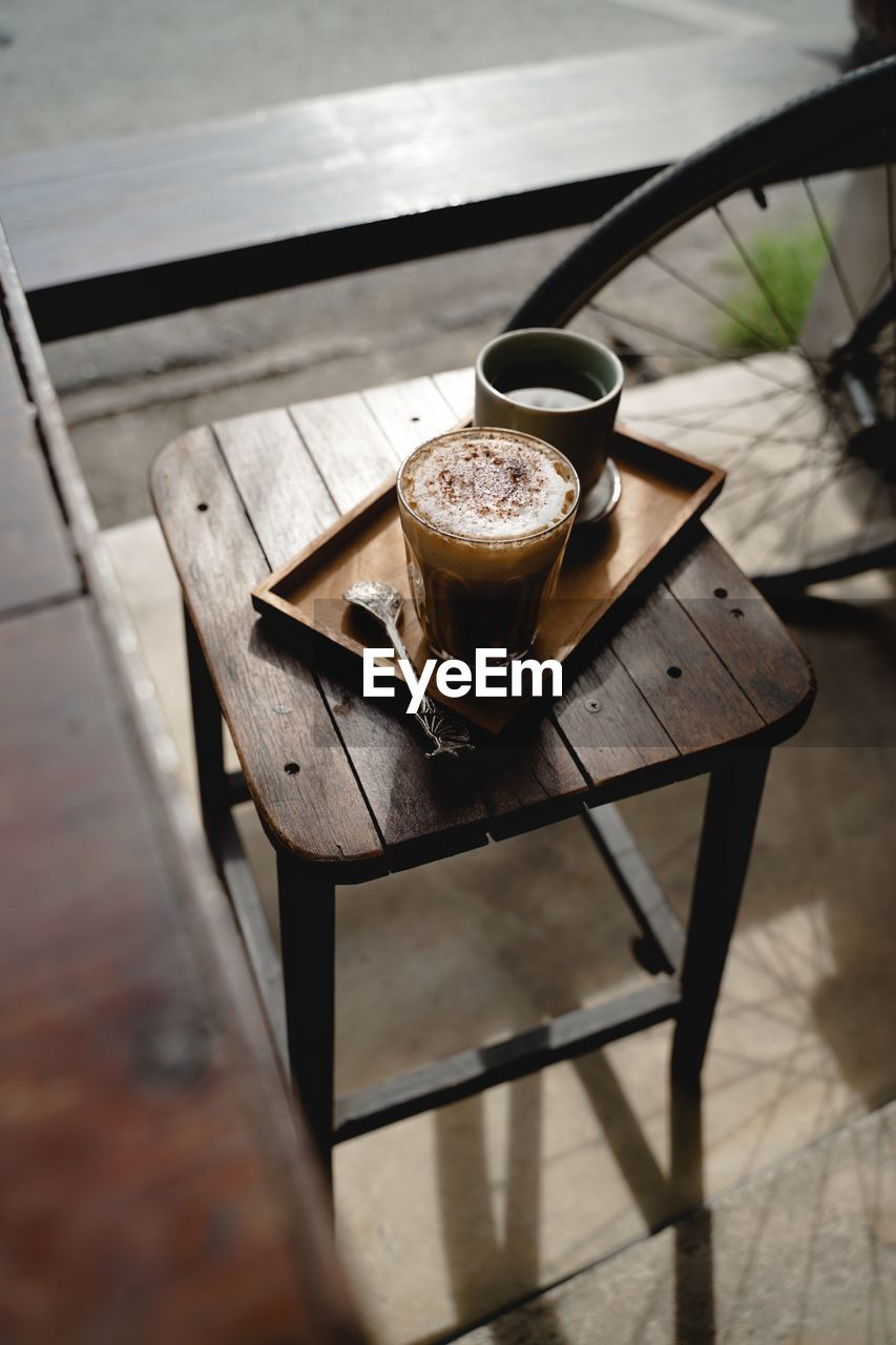 drink, refreshment, food and drink, coffee, table, cup, still life, coffee - drink, wood - material, no people, mug, coffee cup, household equipment, freshness, selective focus, frothy drink, hot drink, day, close-up, glass, latte, tray, froth