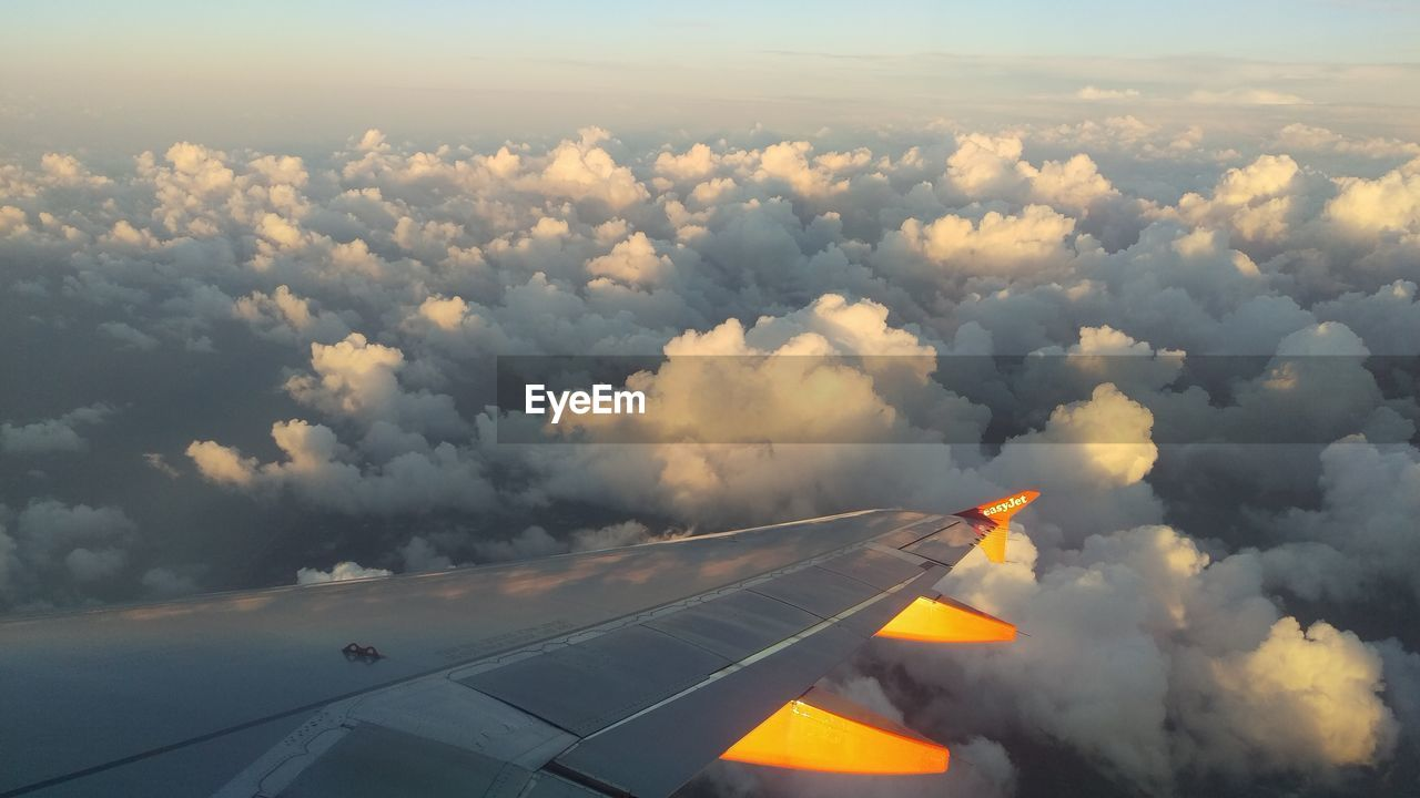 airplane, cloud - sky, transportation, sky, journey, aerial view, airplane wing, nature, cloudscape, air vehicle, aircraft wing, no people, outdoors, travel, mid-air, day, flying, scenics, beauty in nature