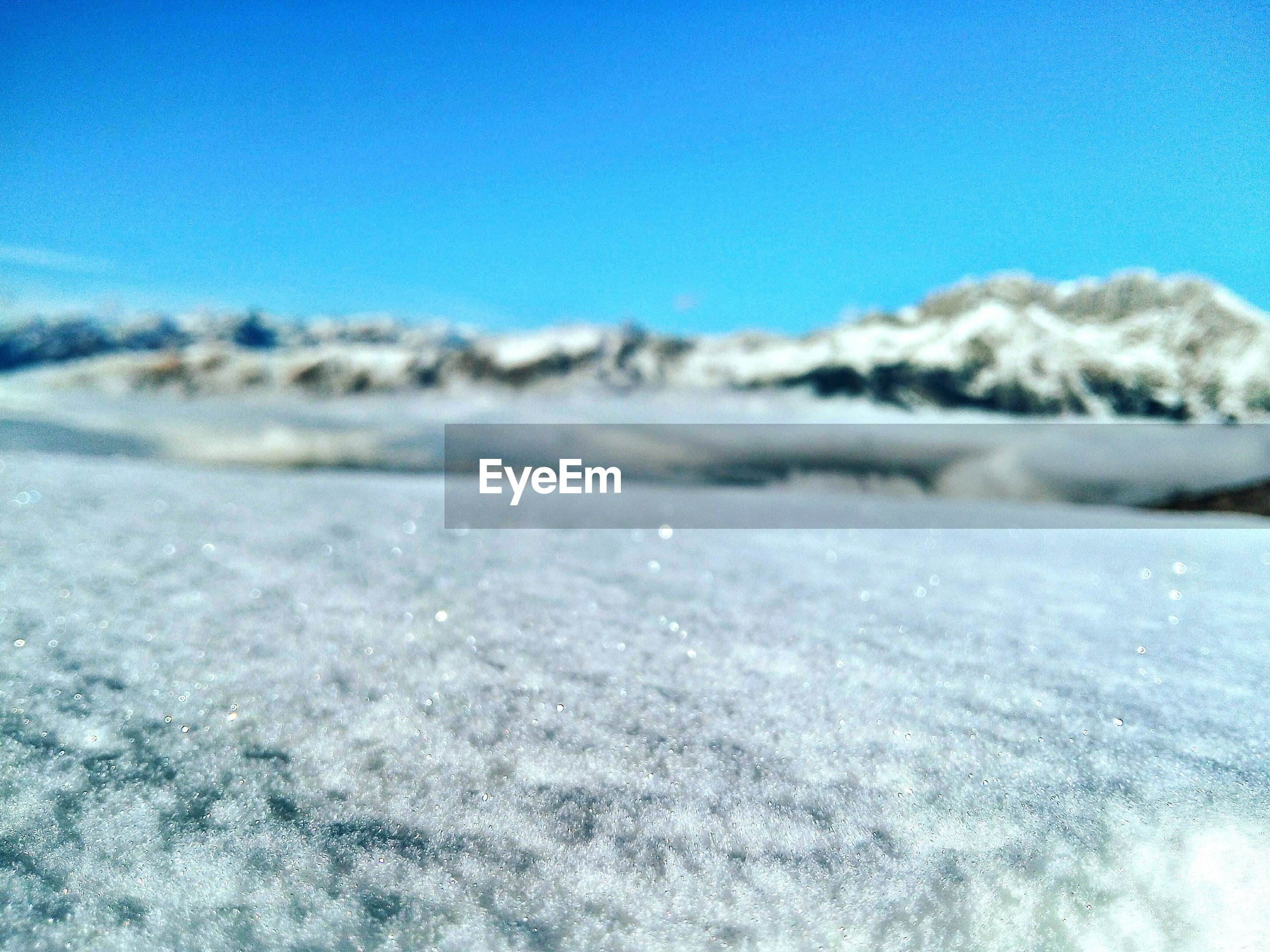 blue, clear sky, beauty in nature, tranquil scene, tranquility, scenics, copy space, nature, sea, water, landscape, beach, winter, idyllic, snow, day, cold temperature, surface level, sand, outdoors