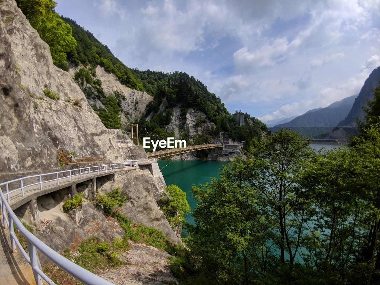mountain, tree, sky, connection, bridge, bridge - man made structure, cloud - sky, transportation, water, plant, nature, day, mountain range, built structure, beauty in nature, architecture, scenics - nature, no people, tranquility, outdoors