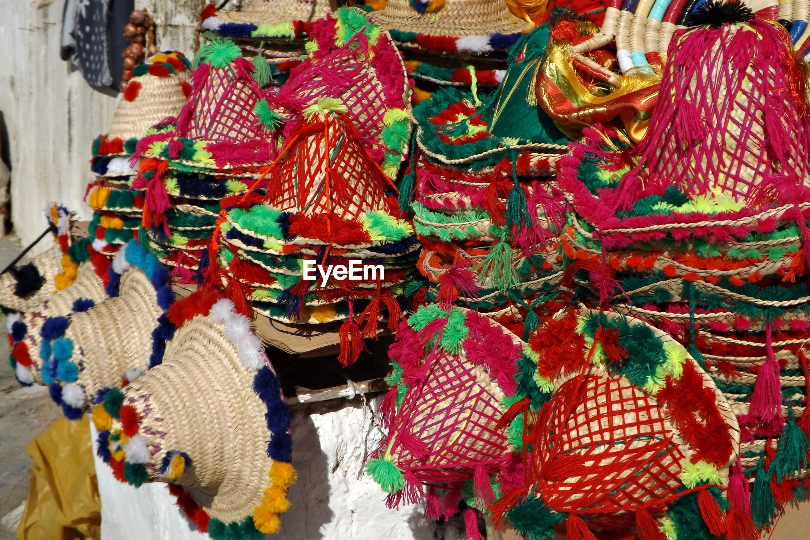 Close-up of colorful hats for sale at market stall