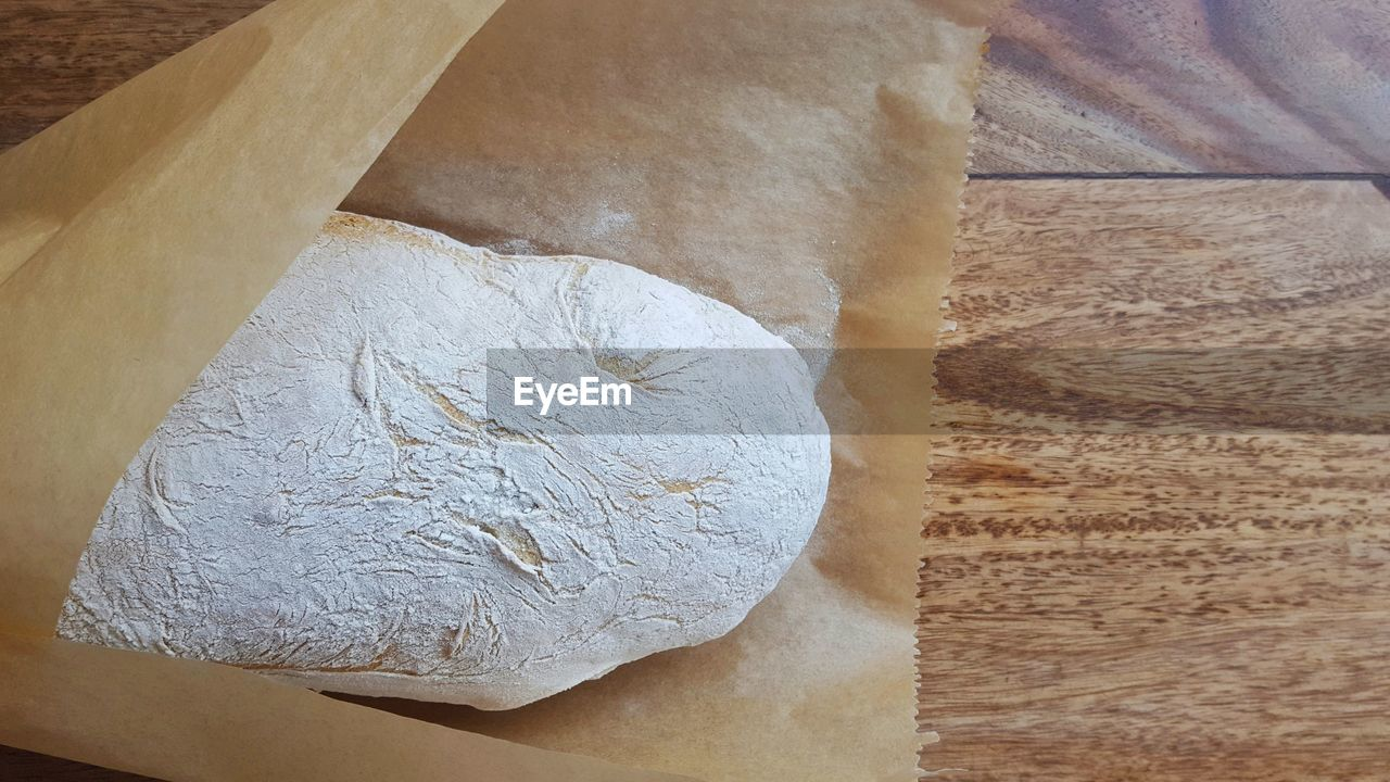bread, indoors, food, food and drink, high angle view, baking bread, loaf of bread, table, close-up, dough, freshness, bakery, no people, healthy eating, day