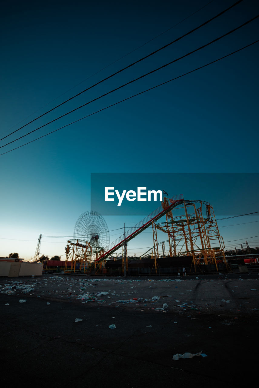 sky, built structure, architecture, nature, no people, amusement park ride, amusement park, cable, clear sky, connection, arts culture and entertainment, blue, outdoors, day, metal, low angle view, ferris wheel, land, electricity, rollercoaster