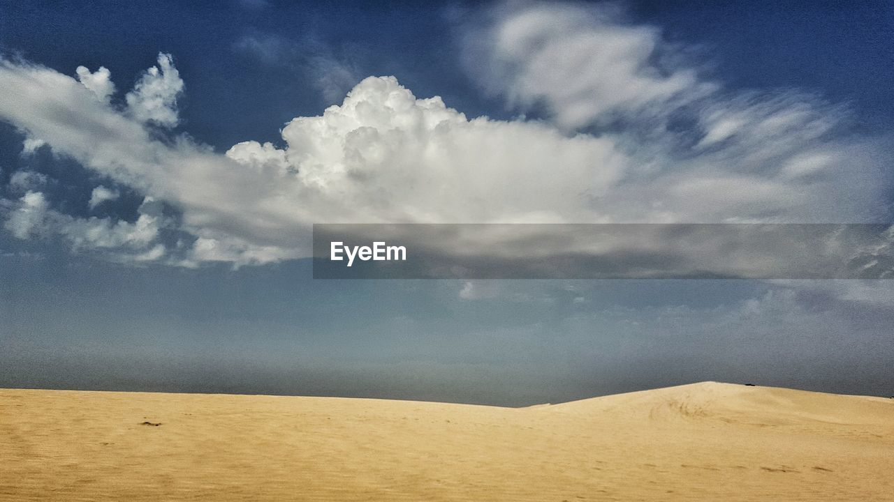 nature, tranquil scene, scenics, sky, tranquility, beauty in nature, cloud - sky, sand, landscape, outdoors, day, sand dune, desert, no people, arid climate, horizon over water