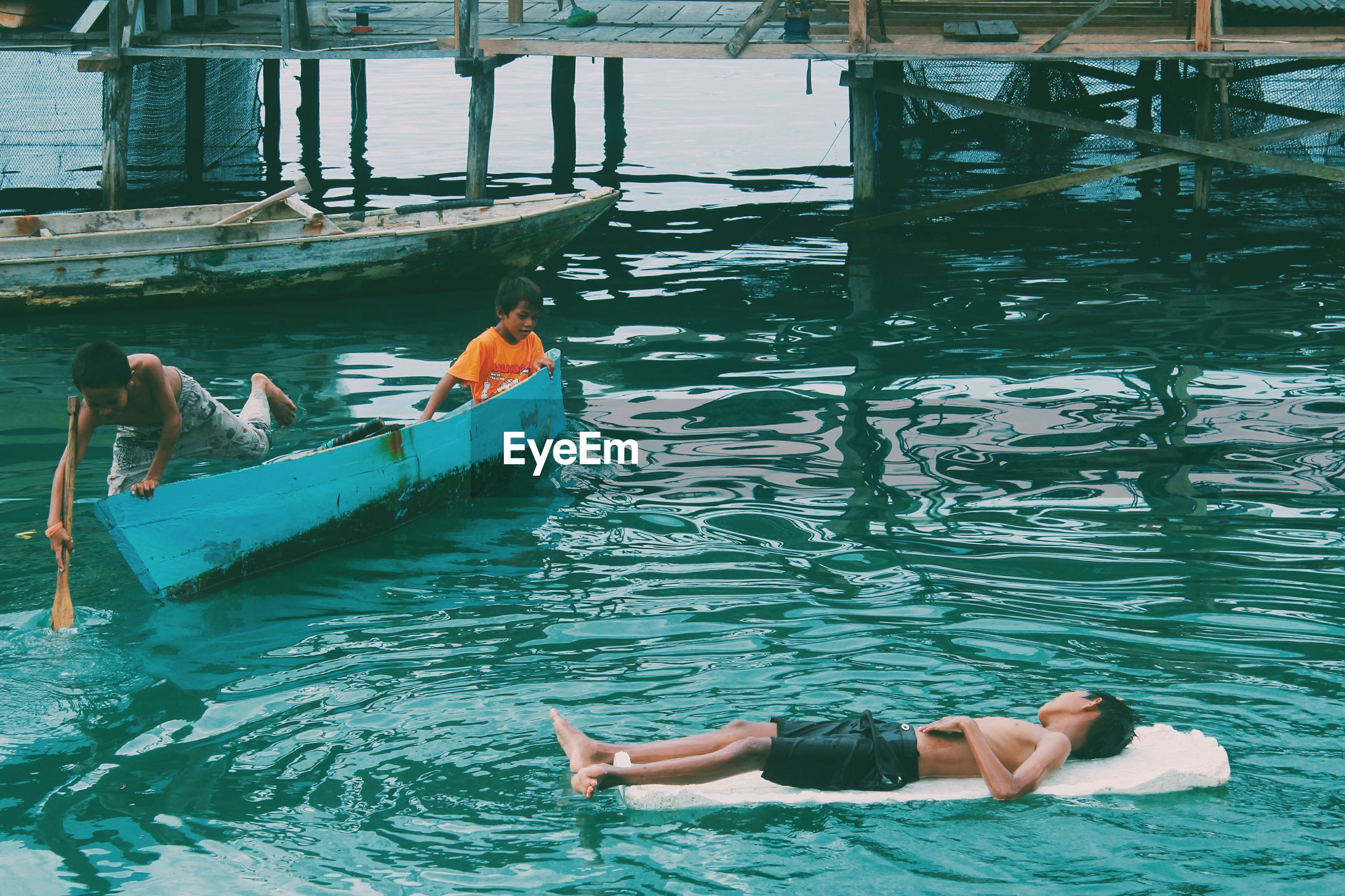 High angle view of boys in river