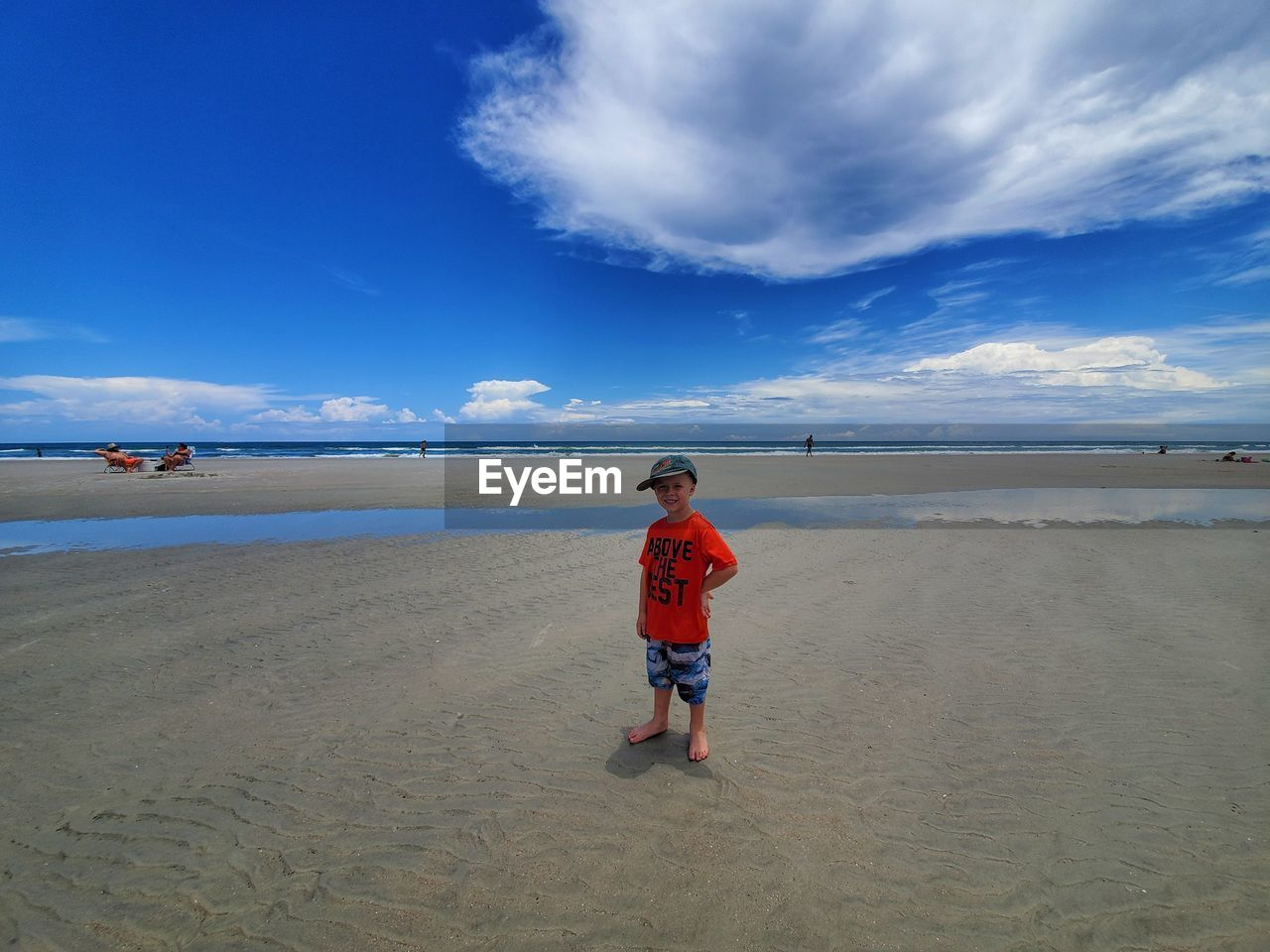sky, beach, land, water, real people, cloud - sky, sand, sea, child, one person, full length, childhood, beauty in nature, scenics - nature, lifestyles, nature, casual clothing, leisure activity, boys, outdoors