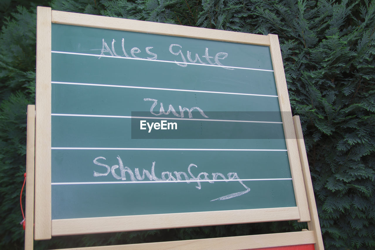 text, western script, communication, day, high angle view, blackboard, no people, outdoors, close-up