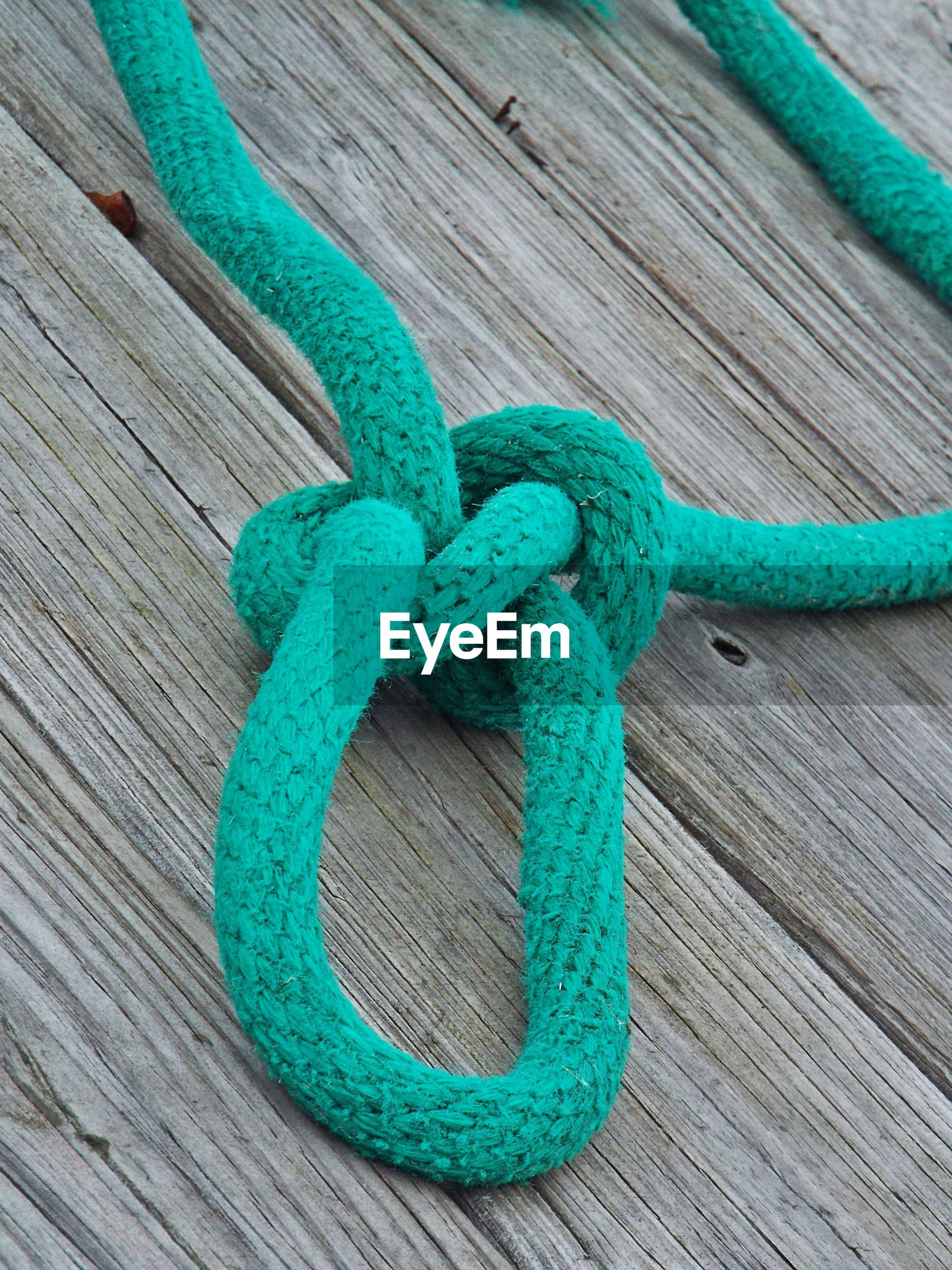 High angle view of blue rope on pier
