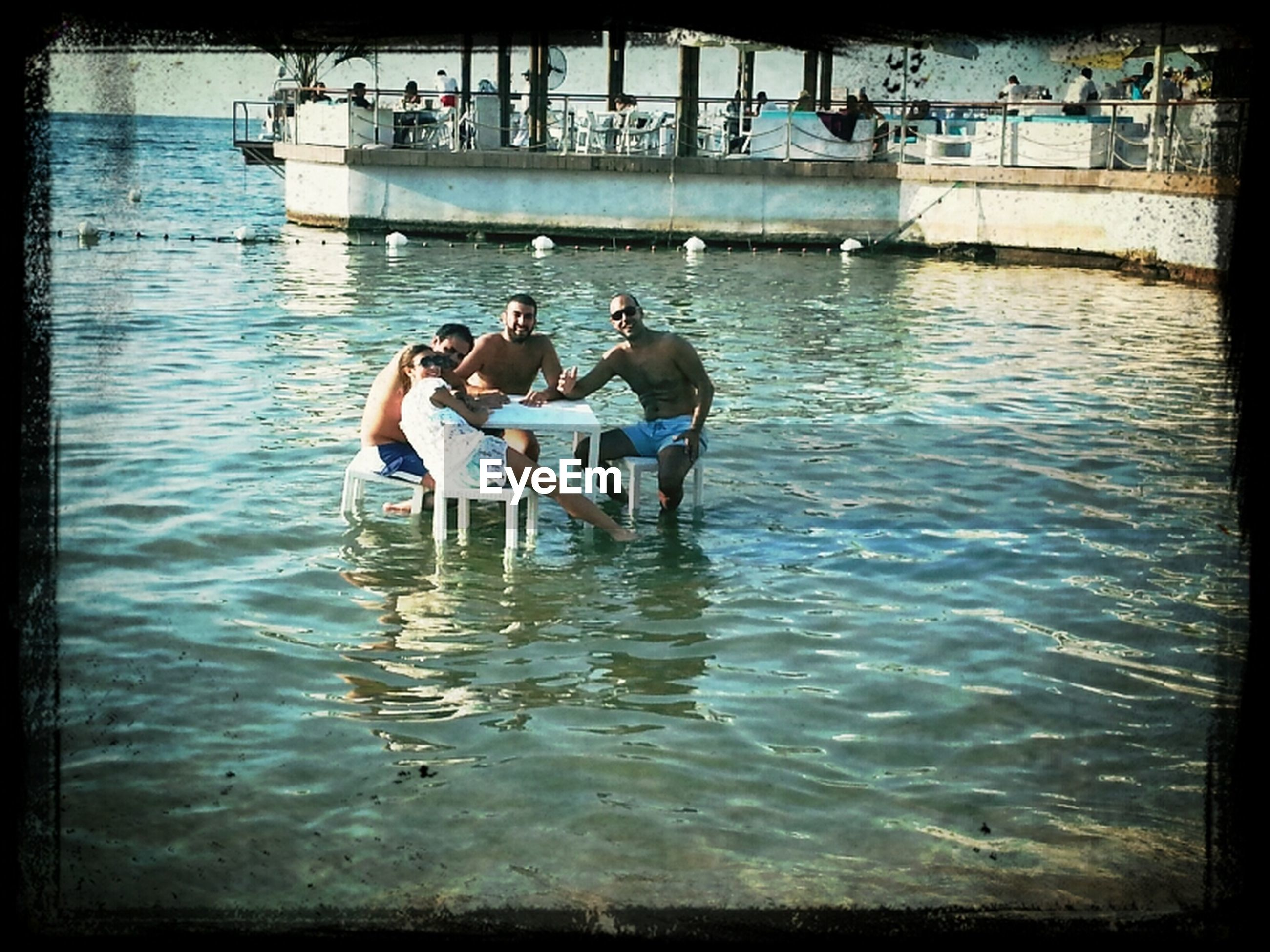 water, transfer print, leisure activity, lifestyles, men, waterfront, auto post production filter, togetherness, reflection, rippled, swimming, sea, full length, person, nature, boys, enjoyment, outdoors