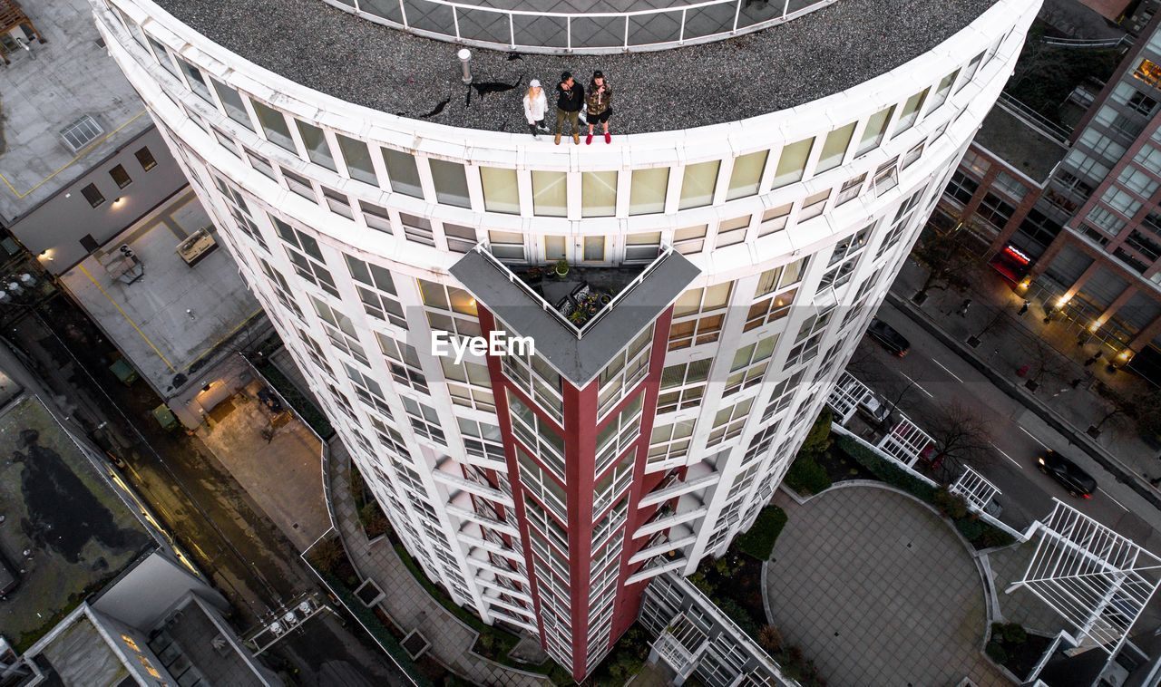 architecture, high angle view, city, building exterior, built structure, city life, modern, business, cityscape, outdoors, day, people, skyscraper, urban skyline, adults only, full length, adult, businessman, fish-eye lens, men, teamwork, futuristic, only men, young adult
