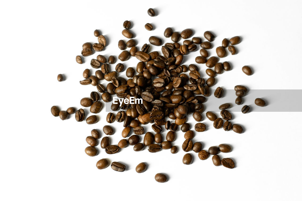 white background, studio shot, indoors, large group of objects, roasted coffee bean, food and drink, coffee - drink, coffee, no people, still life, brown, high angle view, close-up, freshness, food, abundance, coffee bean, roasted, directly above, heap, caffeine