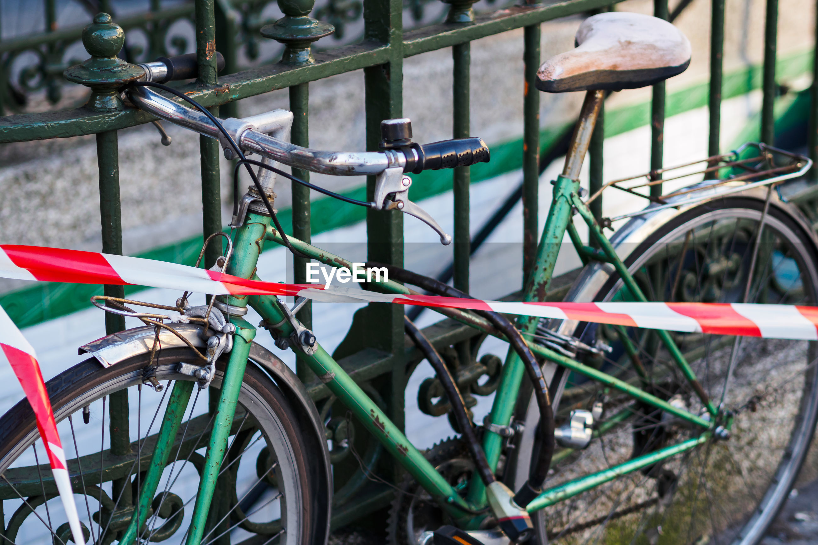 High angle view of bicycle parked by railing
