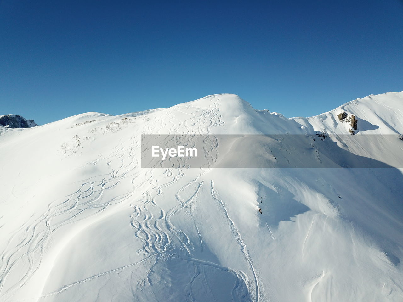 sky, winter, mountain, cold temperature, snow, scenics - nature, beauty in nature, clear sky, tranquility, tranquil scene, white color, blue, snowcapped mountain, day, environment, non-urban scene, copy space, nature, sunlight, mountain range, no people, mountain peak