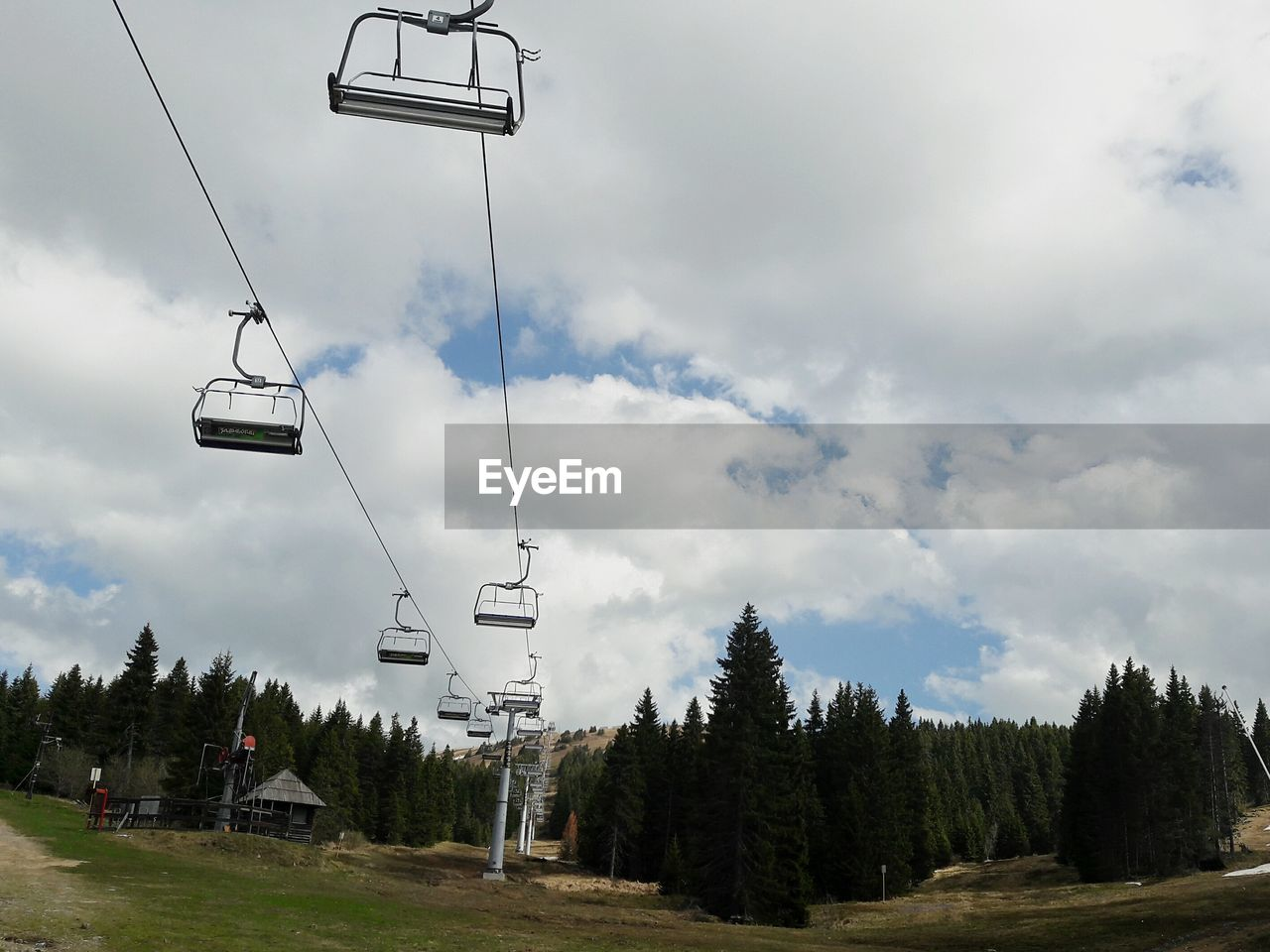sky, cloud - sky, cable car, tree, ski lift, overhead cable car, plant, nature, transportation, day, mode of transportation, scenics - nature, beauty in nature, land, no people, outdoors, travel, non-urban scene, field