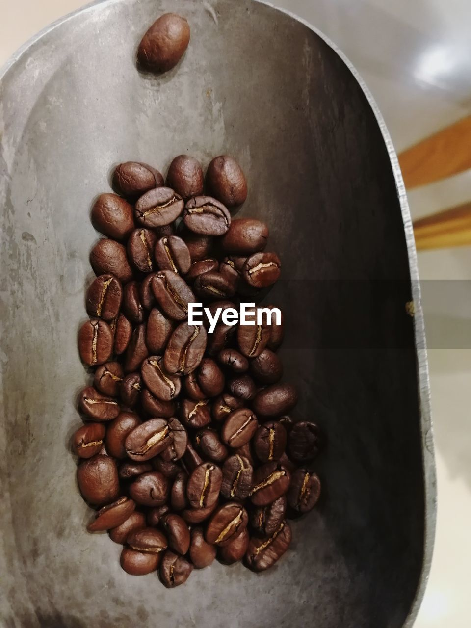 food and drink, coffee, coffee - drink, roasted coffee bean, food, indoors, still life, brown, freshness, large group of objects, close-up, no people, high angle view, coffee bean, table, caffeine, roasted, drink, directly above, refreshment