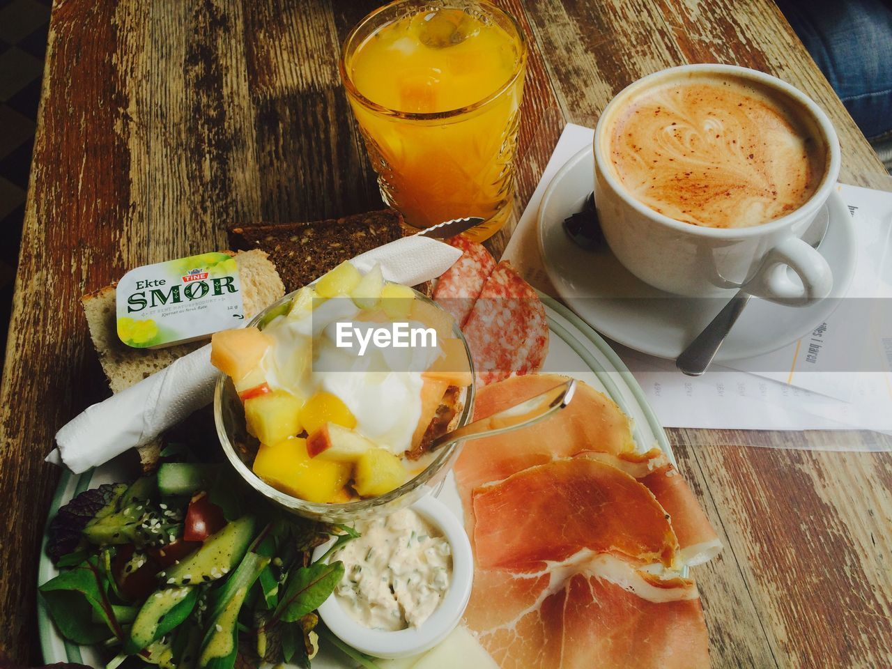 food and drink, freshness, refreshment, drink, food, table, no people, coffee cup, breakfast, indoors, coffee - drink, high angle view, healthy eating, plate, ready-to-eat, close-up, sweet food, frothy drink, day