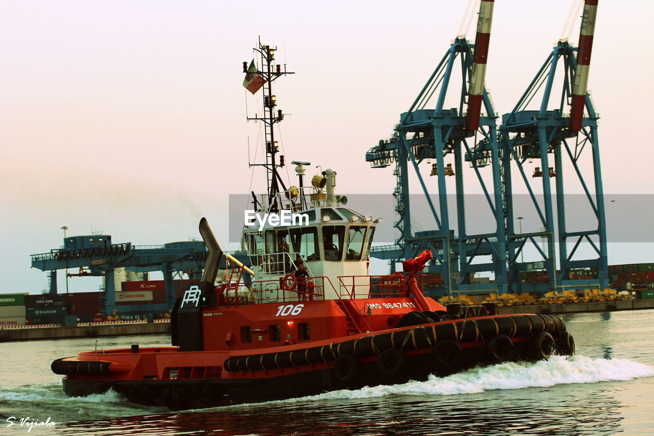 nautical vessel, water, waterfront, transportation, mode of transport, sea, day, harbor, ship, outdoors, sky, red, freight transportation, no people, commercial dock, nature, clear sky, sailing, drilling rig