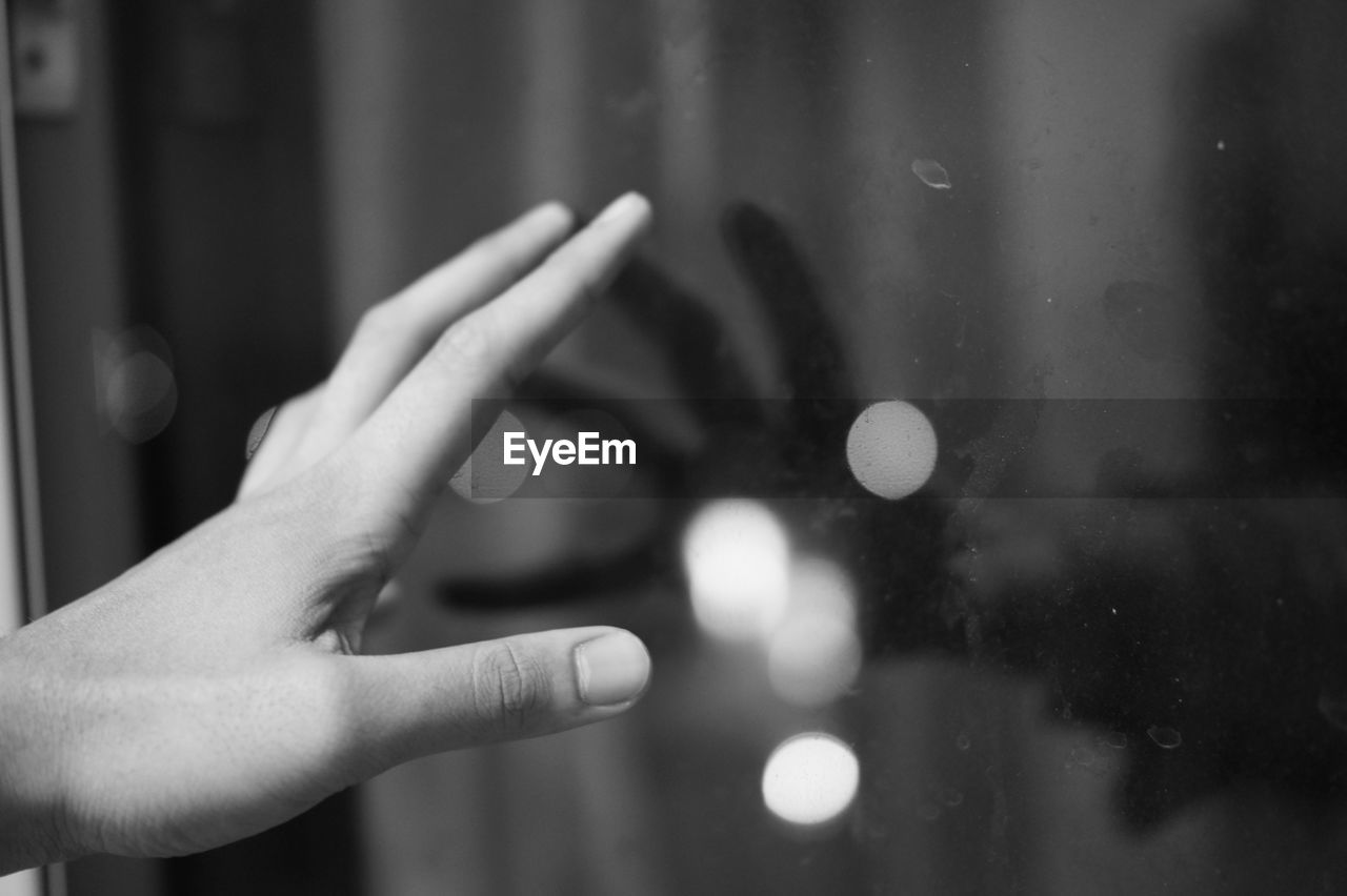 human hand, focus on foreground, human finger, close-up, one person, human body part, window, real people, indoors, day, people