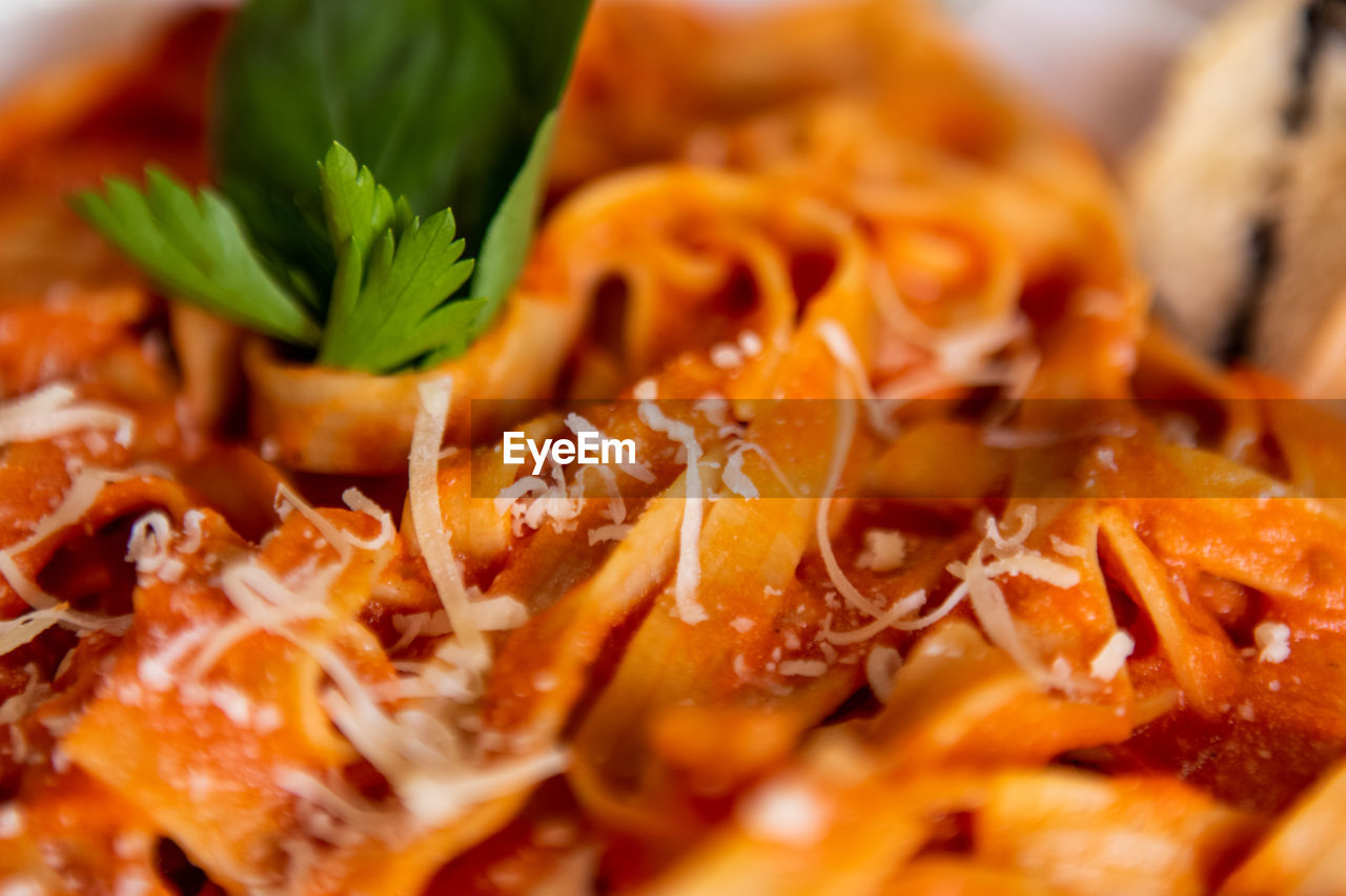 food, food and drink, freshness, healthy eating, ready-to-eat, selective focus, wellbeing, close-up, still life, indoors, no people, vegetable, herb, pasta, indulgence, italian food, orange color, serving size, meat, high angle view, garnish, temptation, spaghetti, chopped, vegetarian food