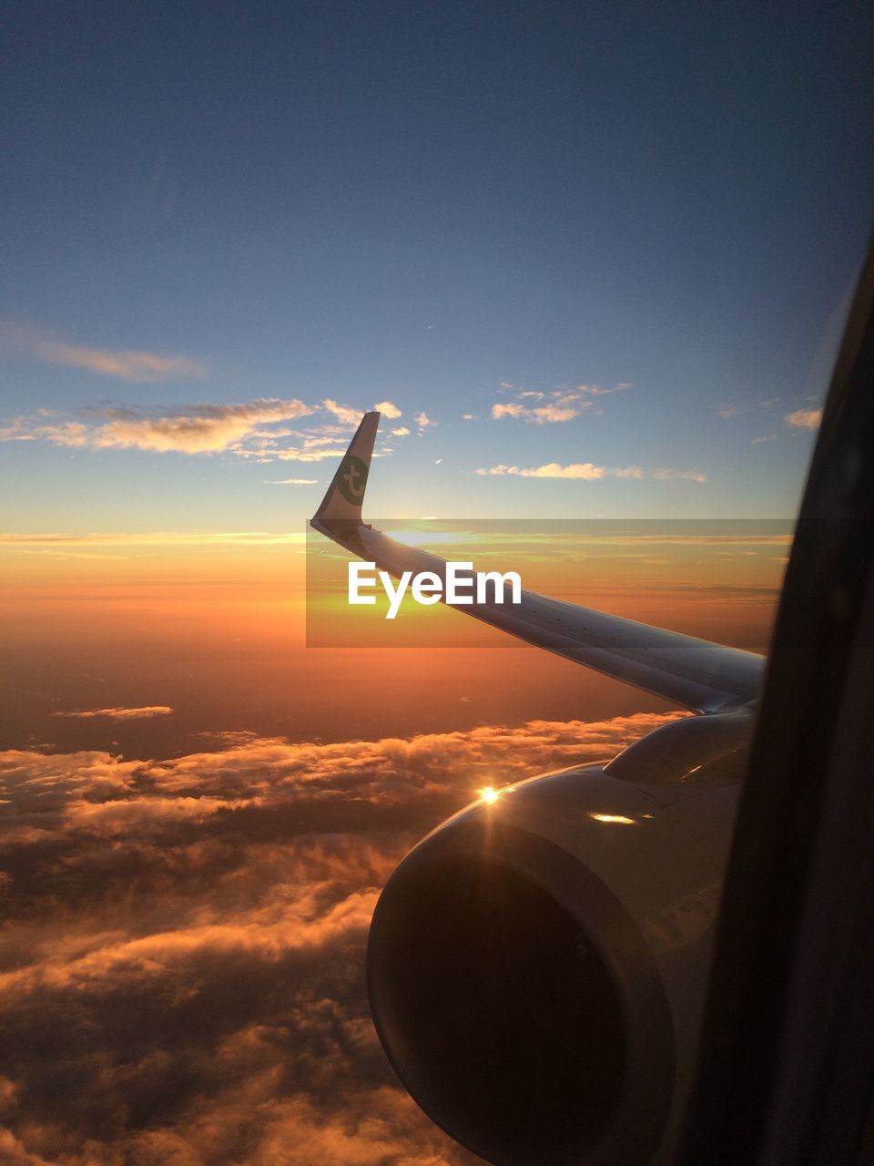 sunset, airplane, sky, orange color, transportation, cloud - sky, air vehicle, mode of transport, nature, scenics, beauty in nature, airplane wing, aircraft wing, flying, mid-air, no people, aerial view, outdoors, day