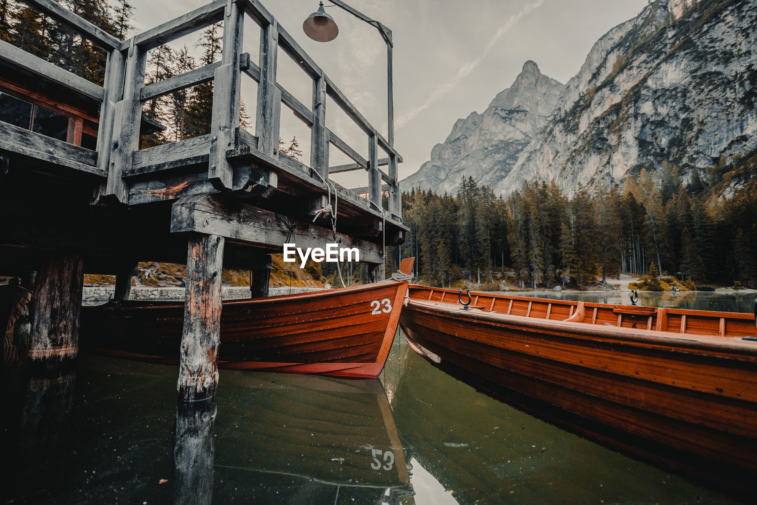 HIGH ANGLE VIEW OF BOATS IN CANAL BY MOUNTAIN