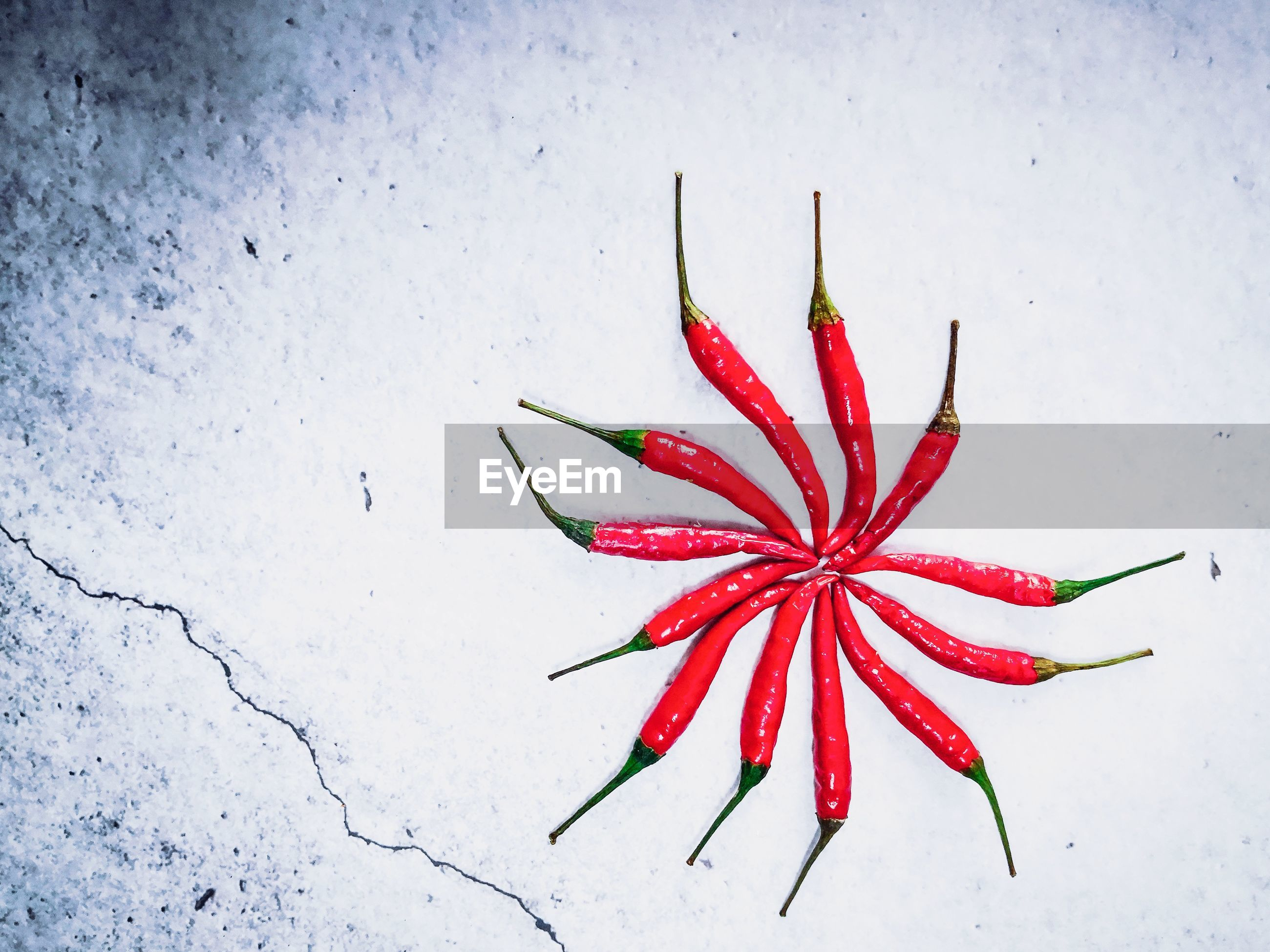 Directly above shot of red chili peppers on table