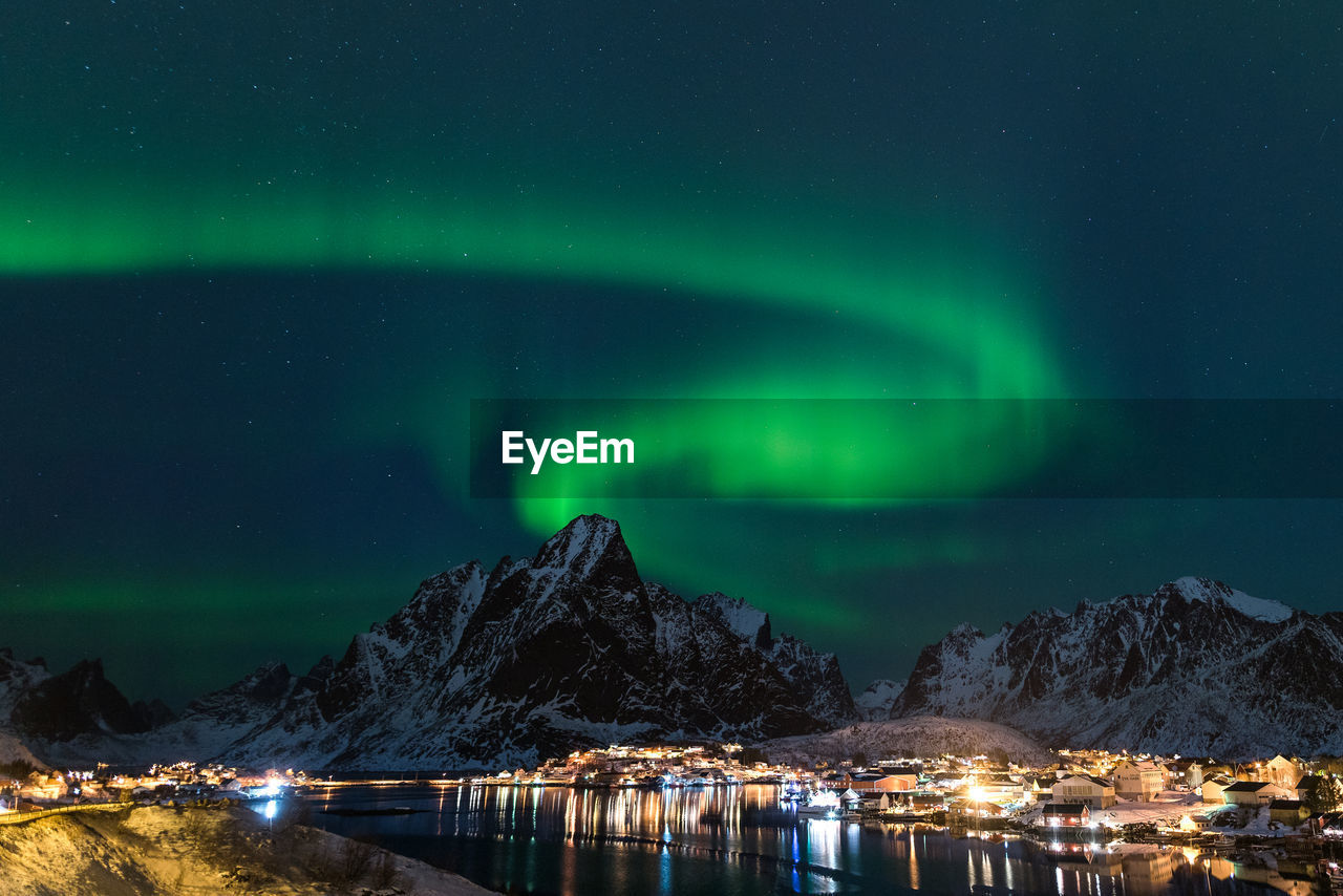 night, beauty in nature, scenics - nature, space, astronomy, star - space, sky, illuminated, green color, mountain, water, no people, idyllic, nature, cold temperature, snow, majestic, tranquility, tranquil scene, aurora polaris, outdoors, space and astronomy, snowcapped mountain