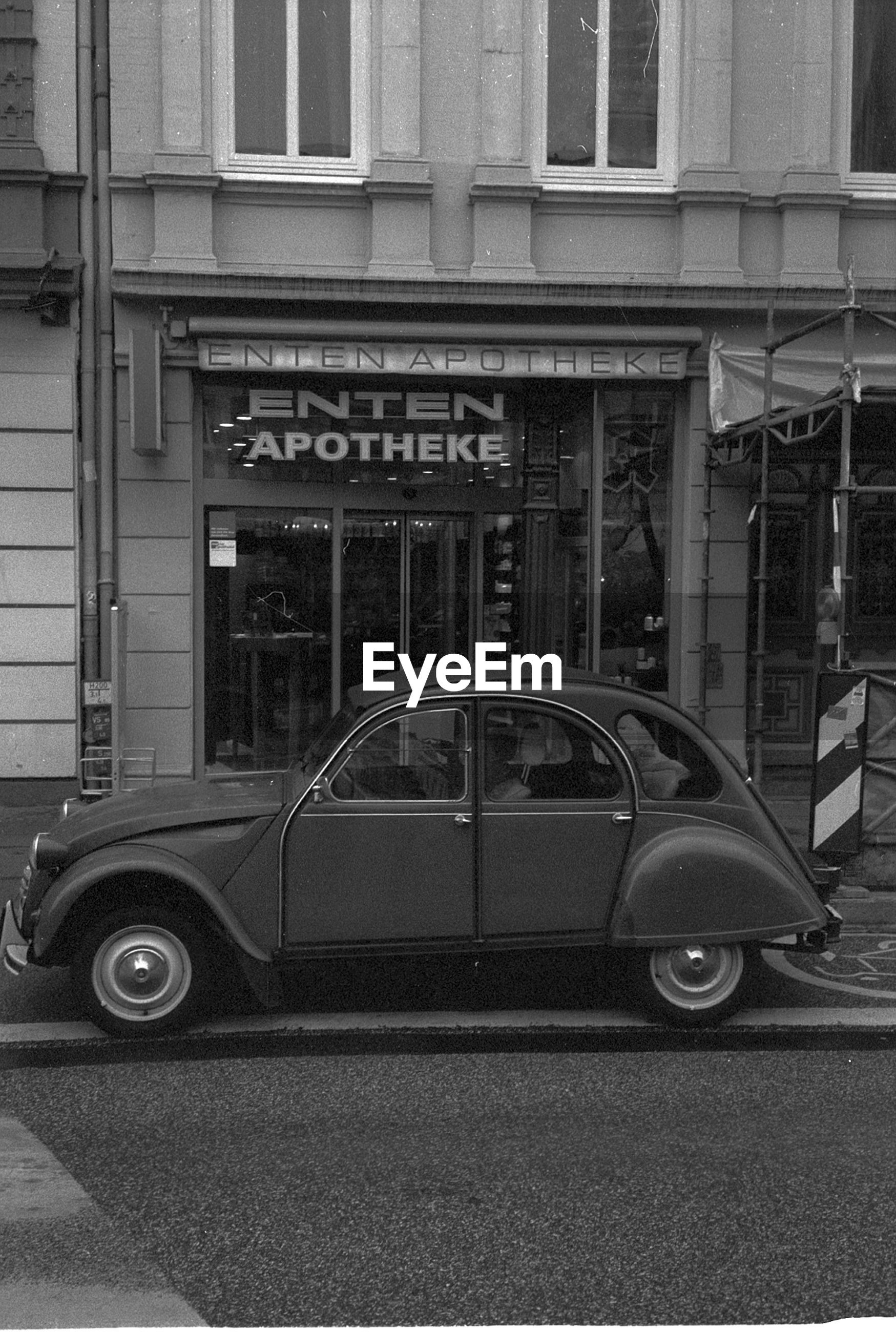 Vintage car on street against building