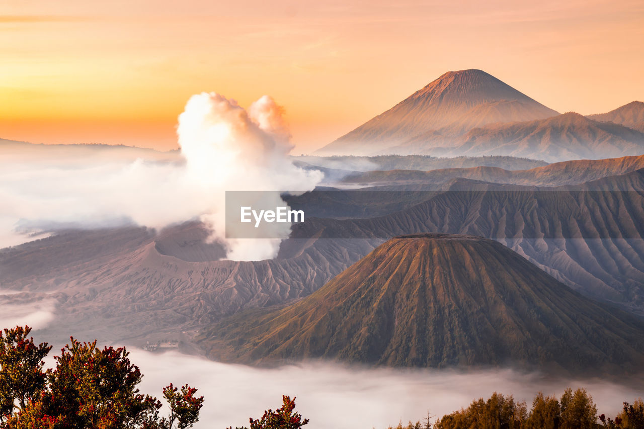 Smoke Emitting From Volcanic Mountain During Sunset