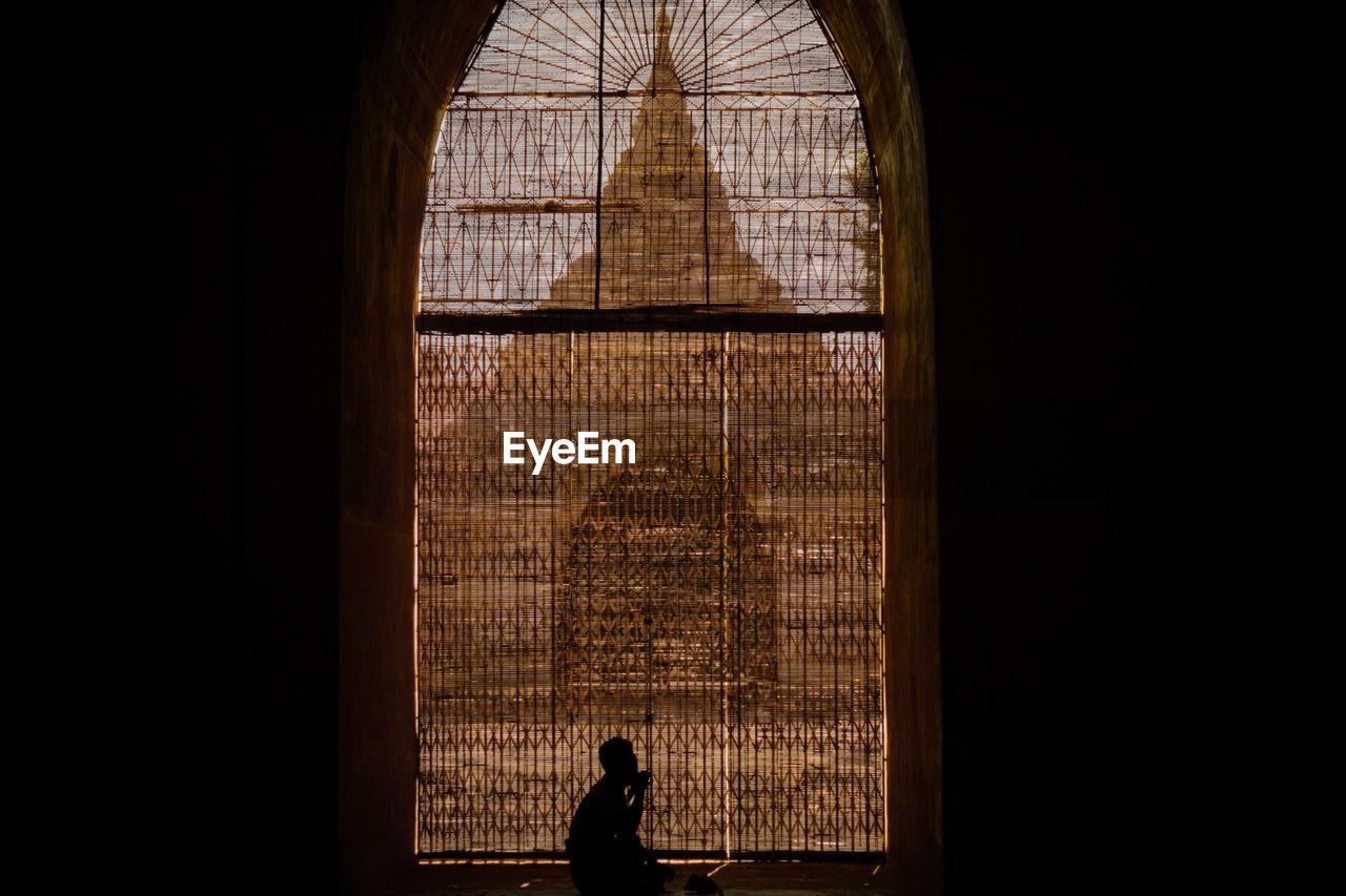 Silhouette Man Sitting By Window