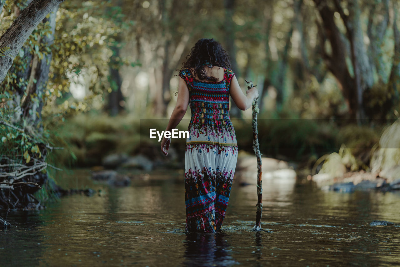 Rear View Of Woman In River