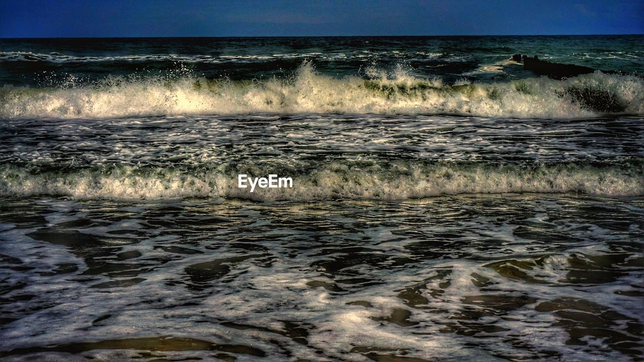 sea, nature, beauty in nature, wave, water, scenics, outdoors, no people, tranquility, motion, tranquil scene, waterfront, horizon over water, sky, day, power in nature, clear sky, beach