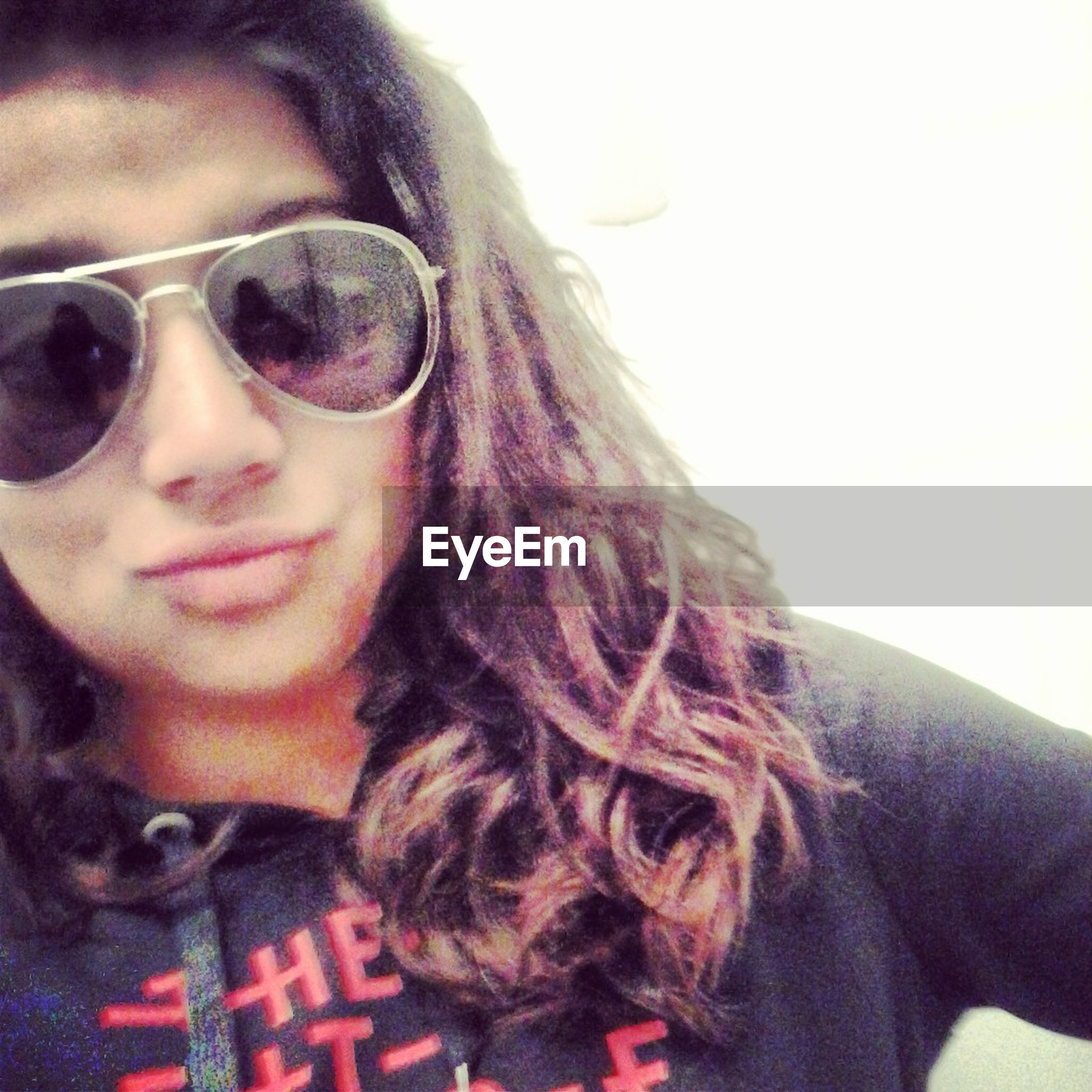 headshot, young adult, person, portrait, looking at camera, lifestyles, young women, leisure activity, head and shoulders, sunglasses, close-up, front view, smiling, human face, long hair, indoors, mid adult