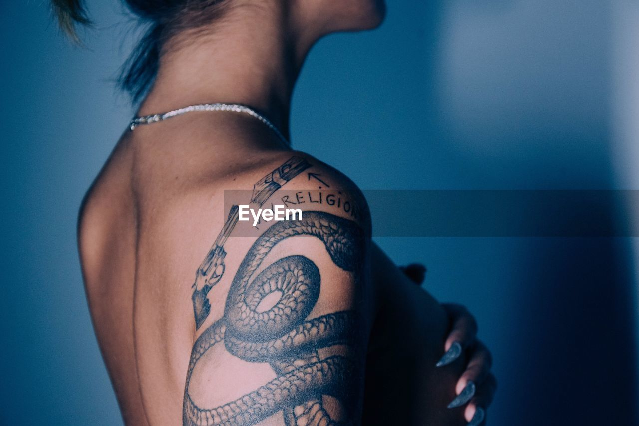 Midsection Of Seductive Woman With Tattoo On Hand