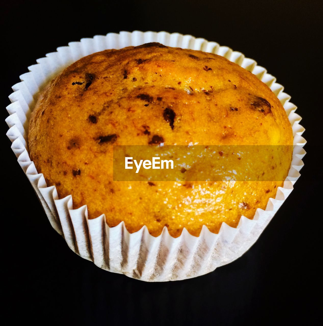 food and drink, food, indoors, sweet food, dessert, indulgence, cupcake, freshness, sweet, close-up, no people, still life, ready-to-eat, baked, black background, unhealthy eating, muffin, temptation, studio shot, cupcake holder, tart - dessert, snack, paper plate