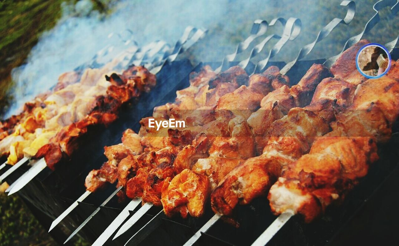 barbecue, barbecue grill, grilled, food and drink, smoke - physical structure, meat, food, preparation, skewer, heat - temperature, no people, high angle view, outdoors, day, close-up, burning, freshness, ready-to-eat