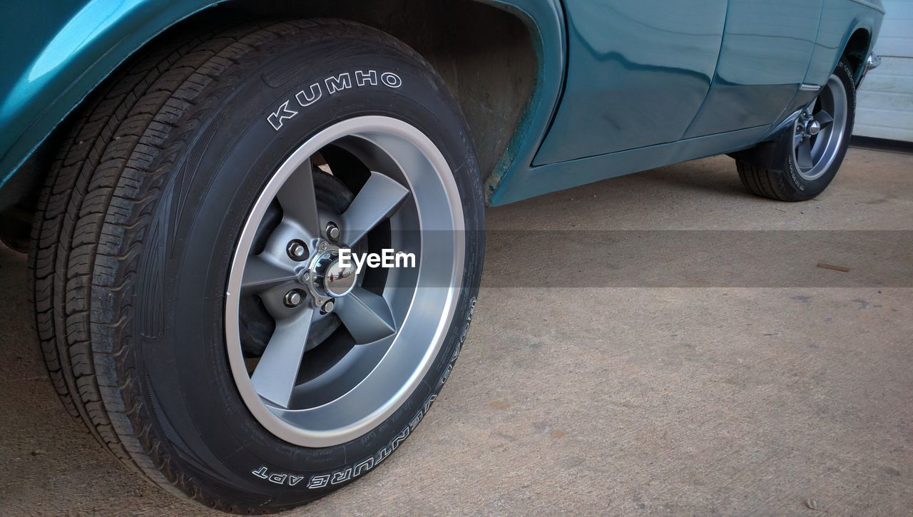 tire, transportation, wheel, land vehicle, stationary, mode of transport, car, day, outdoors, low section, no people, close-up