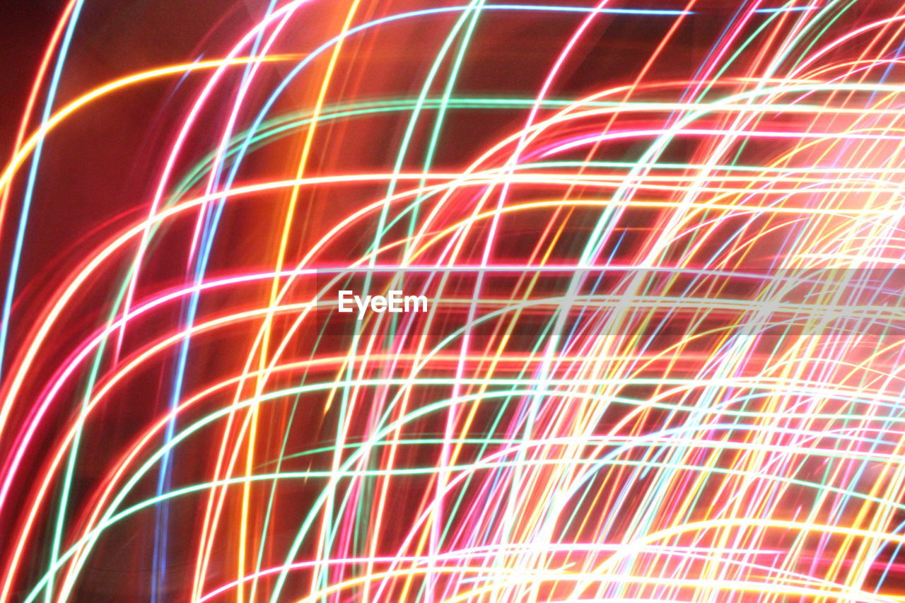multi colored, illuminated, motion, no people, long exposure, blurred motion, light trail, night, low angle view, technology, sky, outdoors, close-up