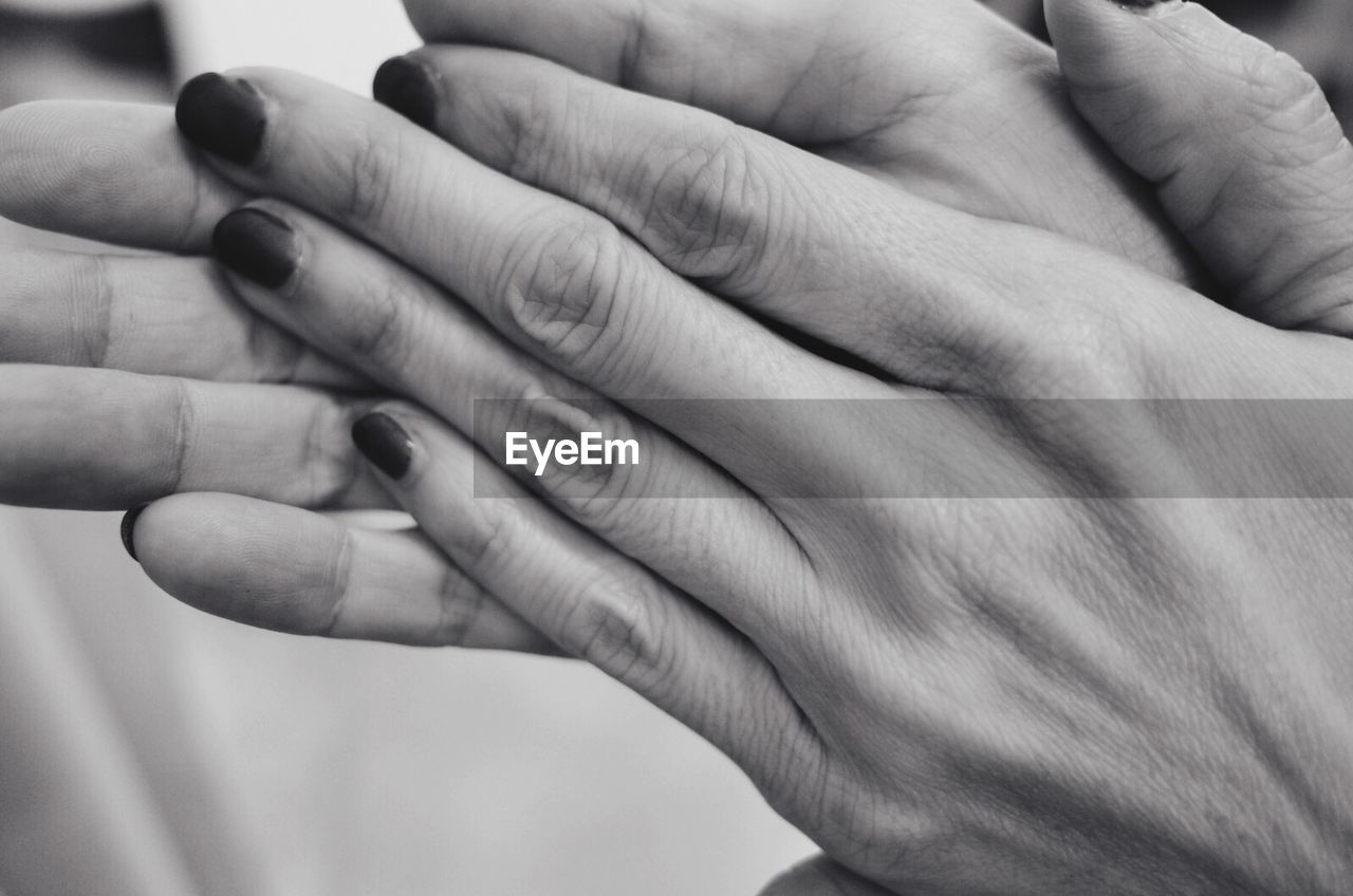 human hand, human finger, human body part, close-up, togetherness, real people, focus on foreground, two people, women, men, bonding, finger ring, fingernail, day, outdoors, adult, people