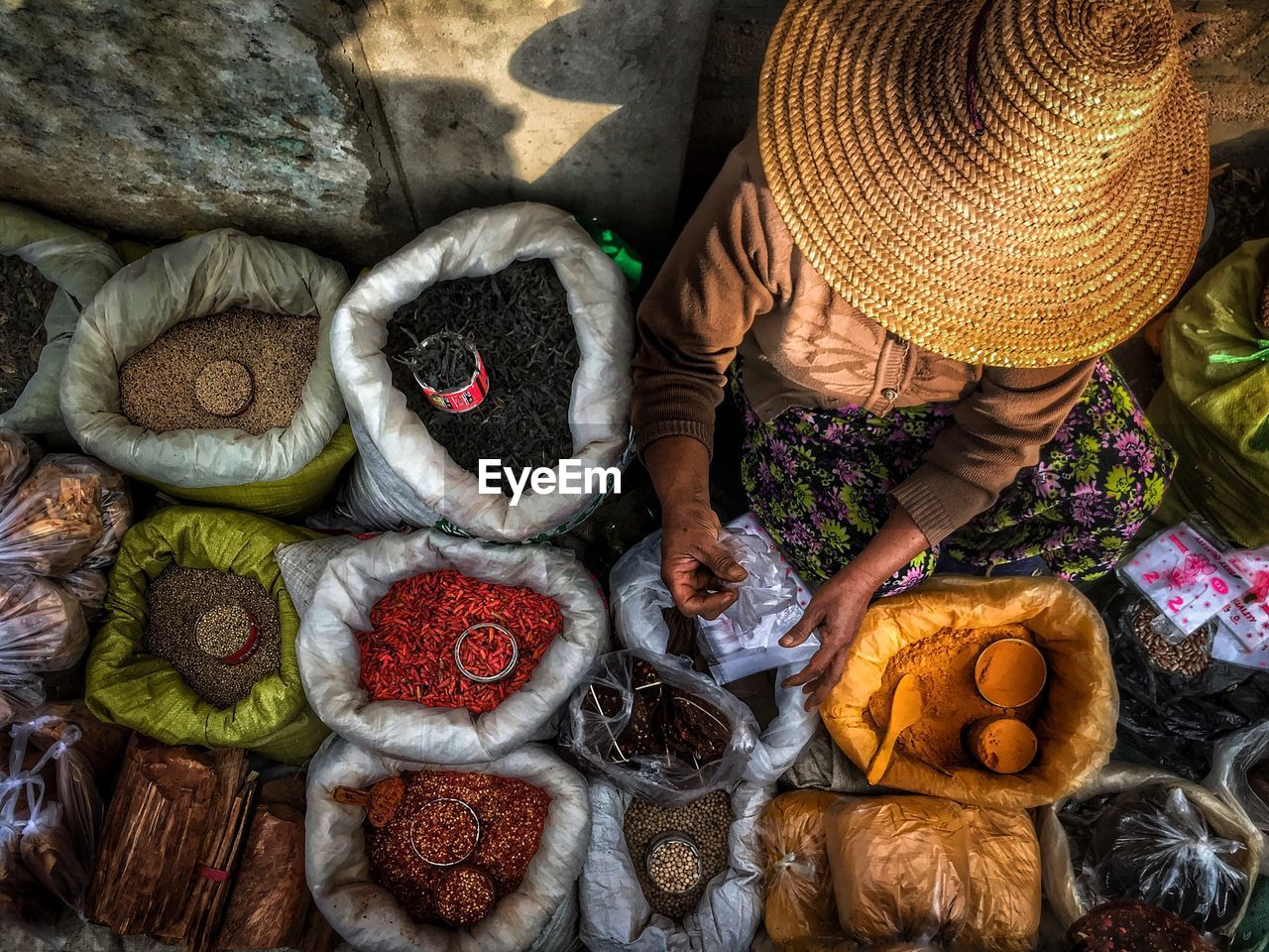 real people, food and drink, food, high angle view, clothing, hat, people, women, day, adult, men, basket, market, choice, large group of objects, for sale, freshness, retail, outdoors