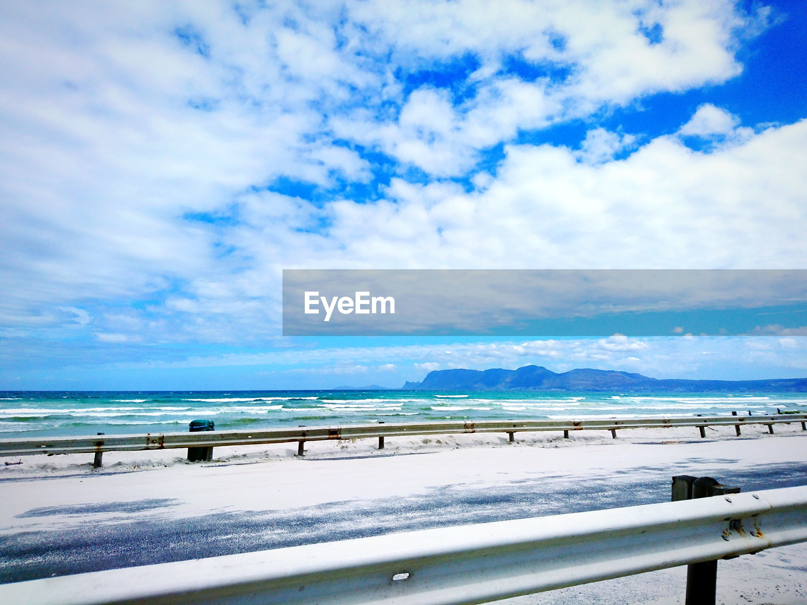 sea, sky, scenics, water, tranquility, cloud - sky, day, tranquil scene, blue, nature, beauty in nature, railing, outdoors, no people, horizon over water, beach