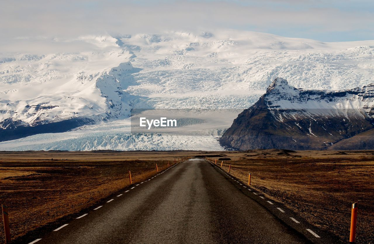 snow, winter, cold temperature, mountain, scenics - nature, beauty in nature, road, transportation, tranquil scene, environment, direction, snowcapped mountain, the way forward, sky, mountain range, no people, tranquility, landscape, nature, diminishing perspective