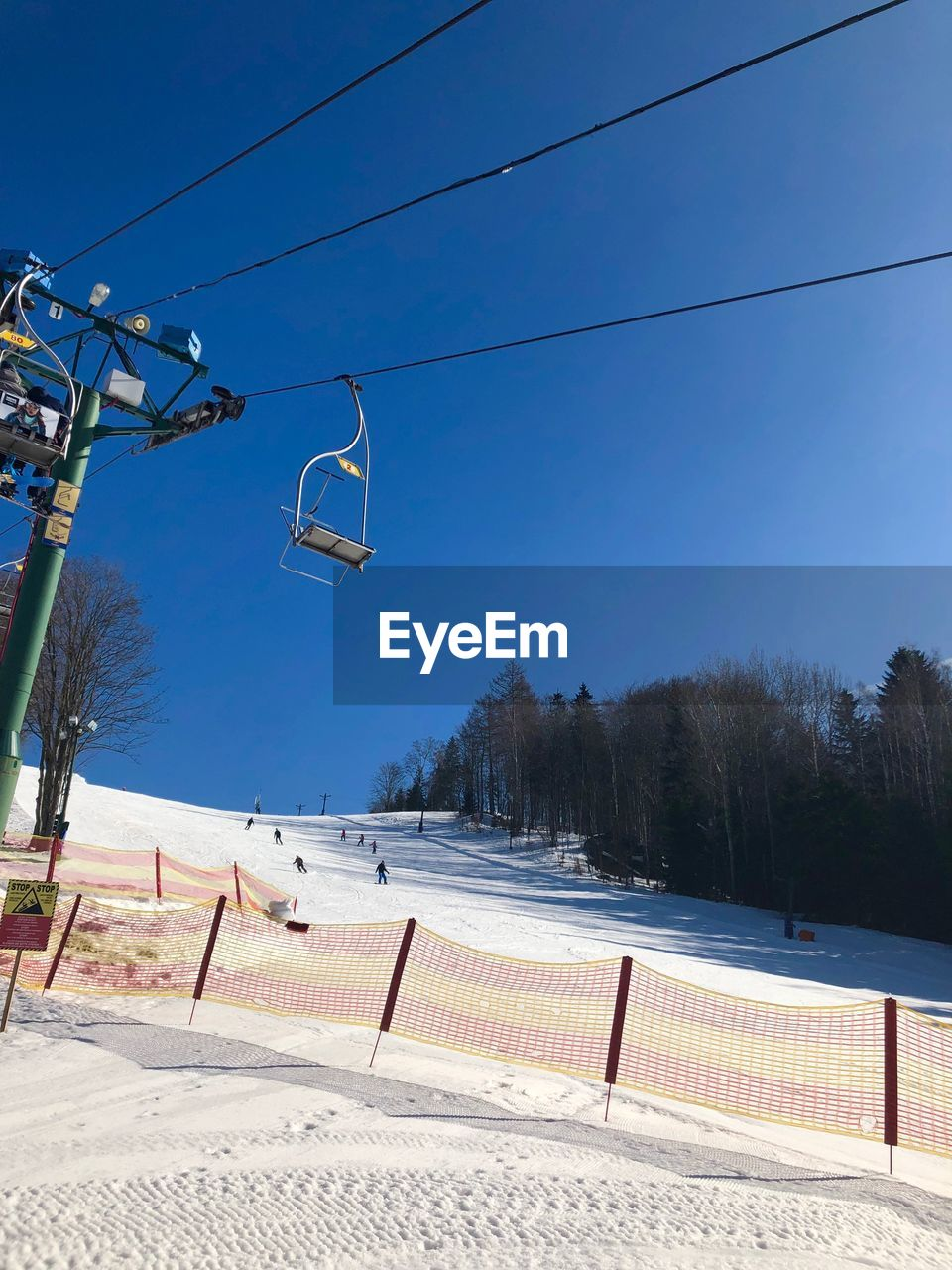 sky, winter, nature, blue, tree, day, cold temperature, snow, plant, cable car, sport, sunlight, clear sky, mountain, no people, transportation, absence, cable, ski lift, outdoors